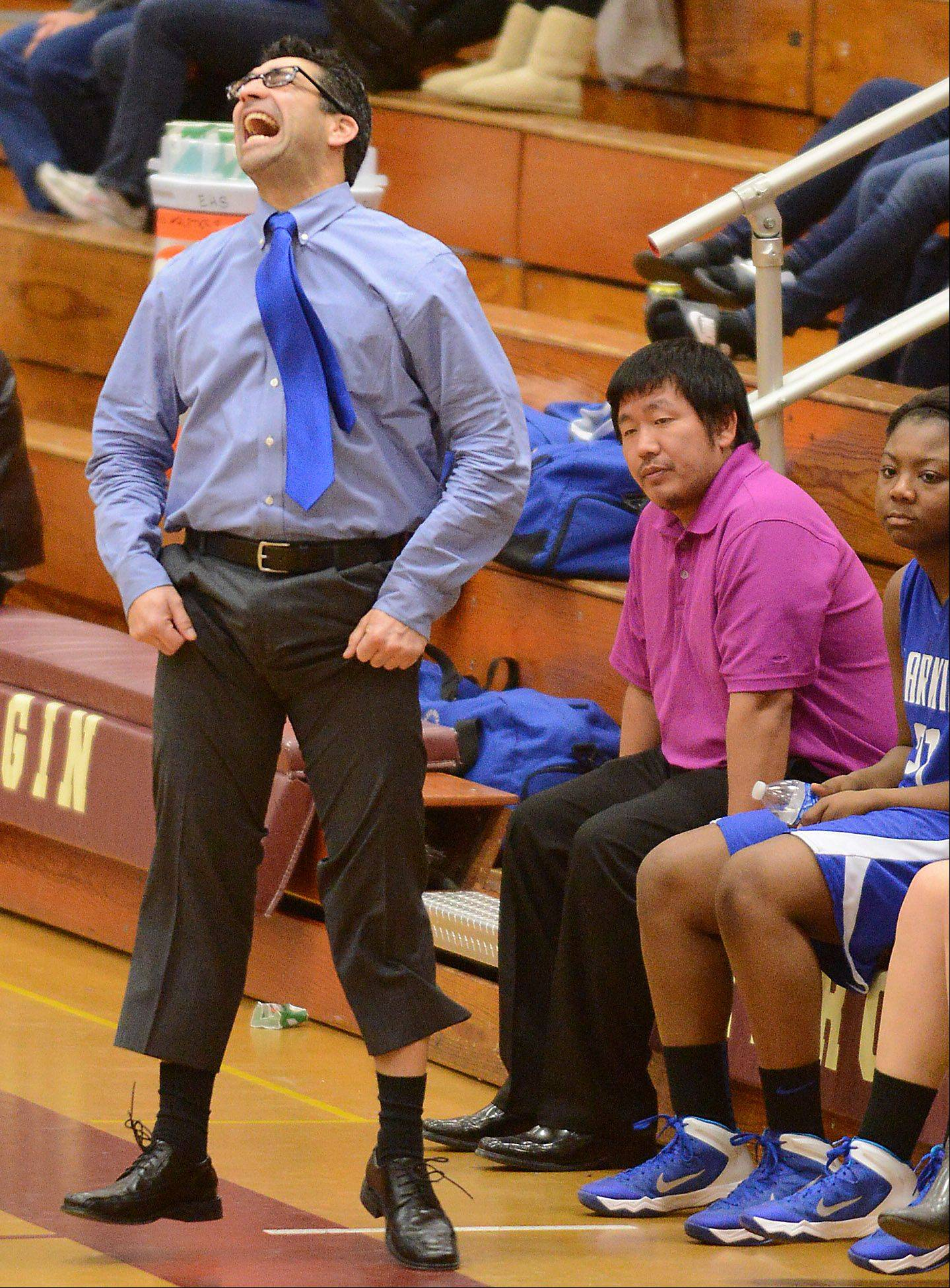 Larkin coach Ruben Flores reacts to the action on floor during Friday's game in Elgin.
