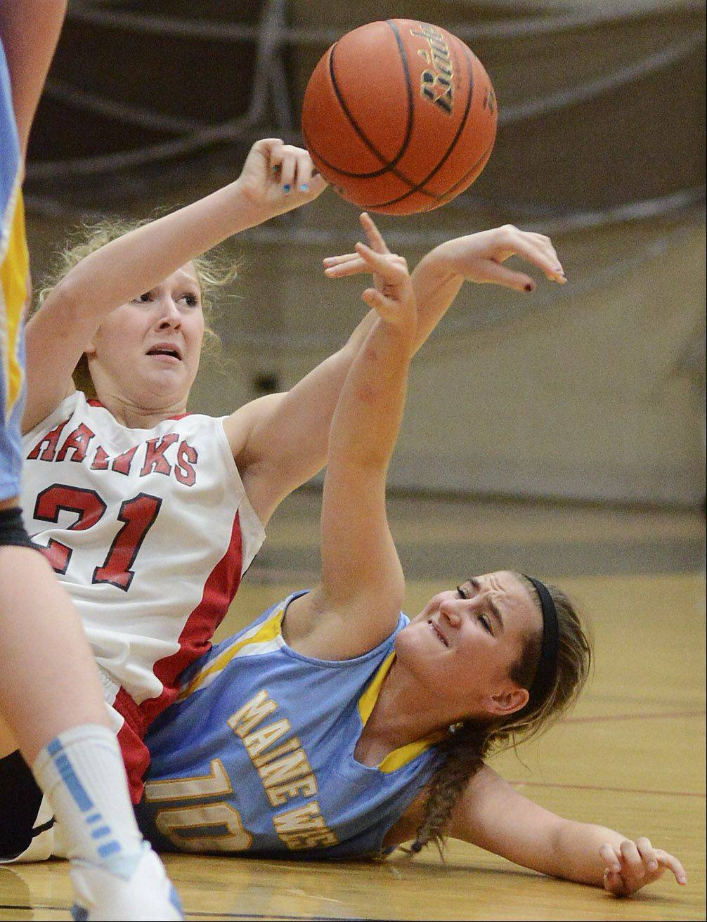 Maine South's Megan Roberts, left, and Maine West's Erin Ross dive to the floor for a loose ball Tuesday.