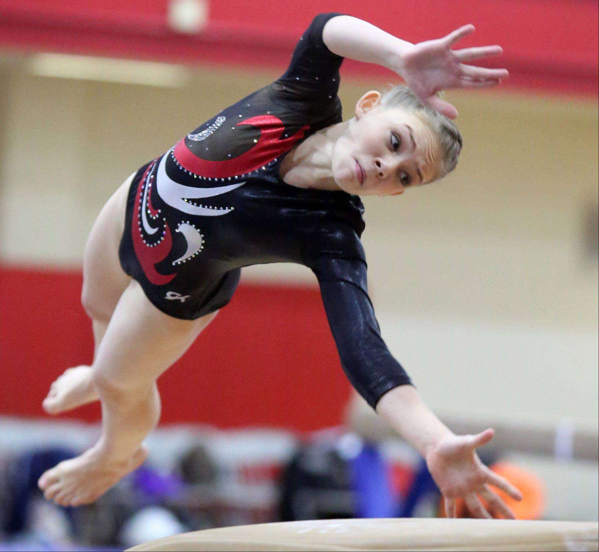 Palatine's Kara Ure competes on the vault at the 25th Annual Palatine Invitational on Saturday.
