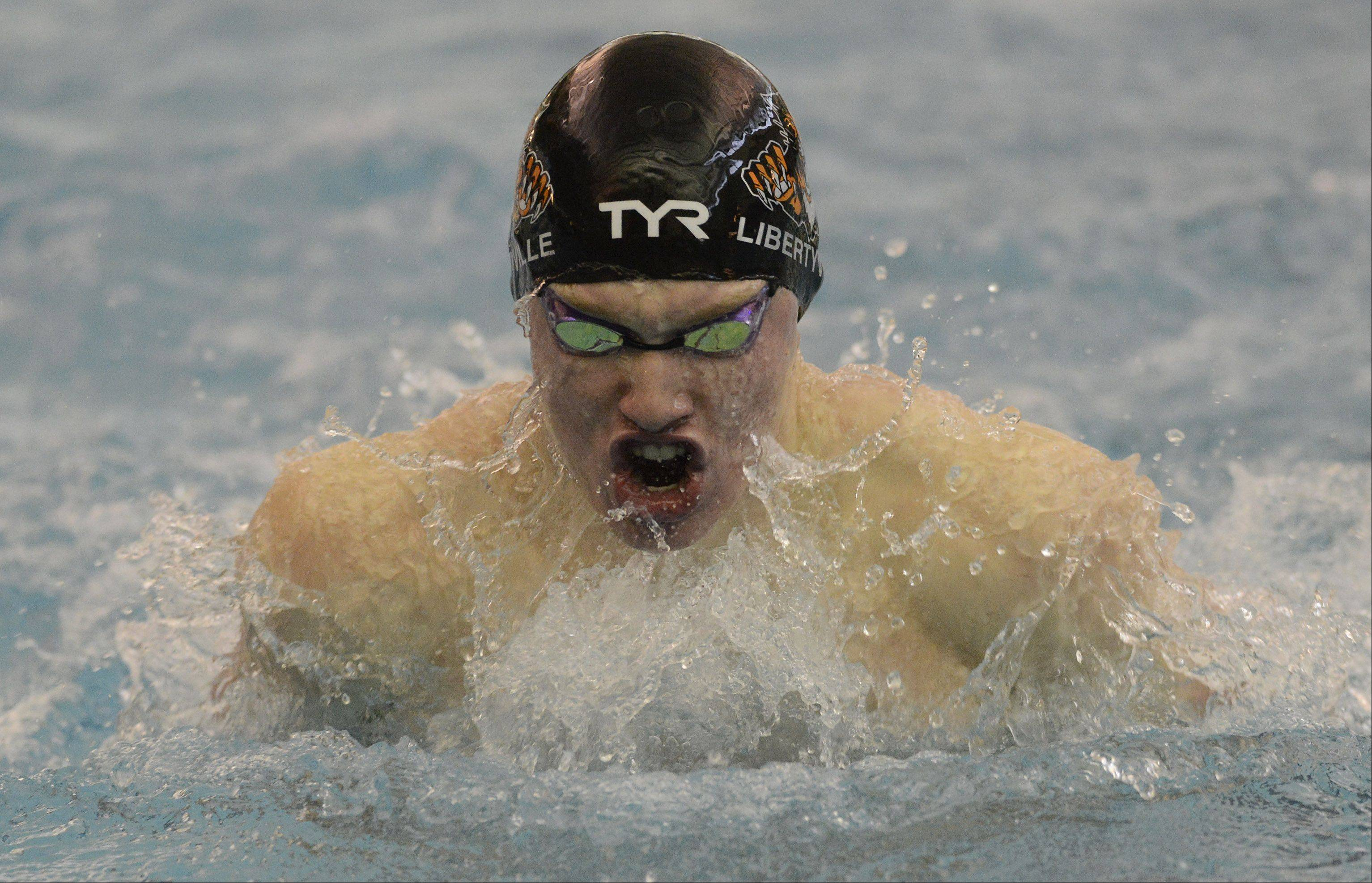 Libertyville's Bobby Snader swims the breaststroke event at the Lake County boys swimming meet in Lincolnshire Saturday.
