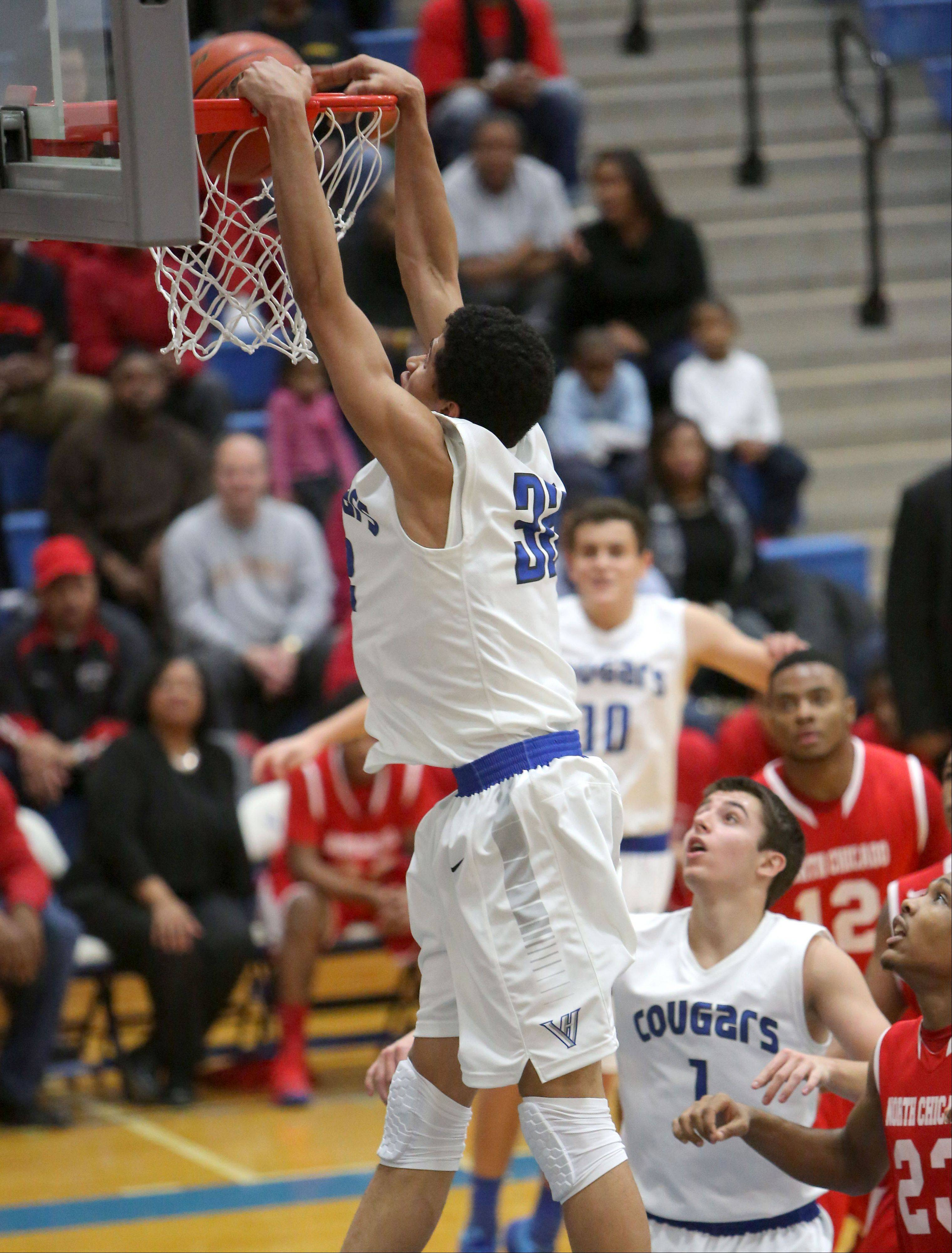 Vernon Hills' Lem Turner goes for the dunk during Tuesday's game against North Chicago in Vernon Hills.