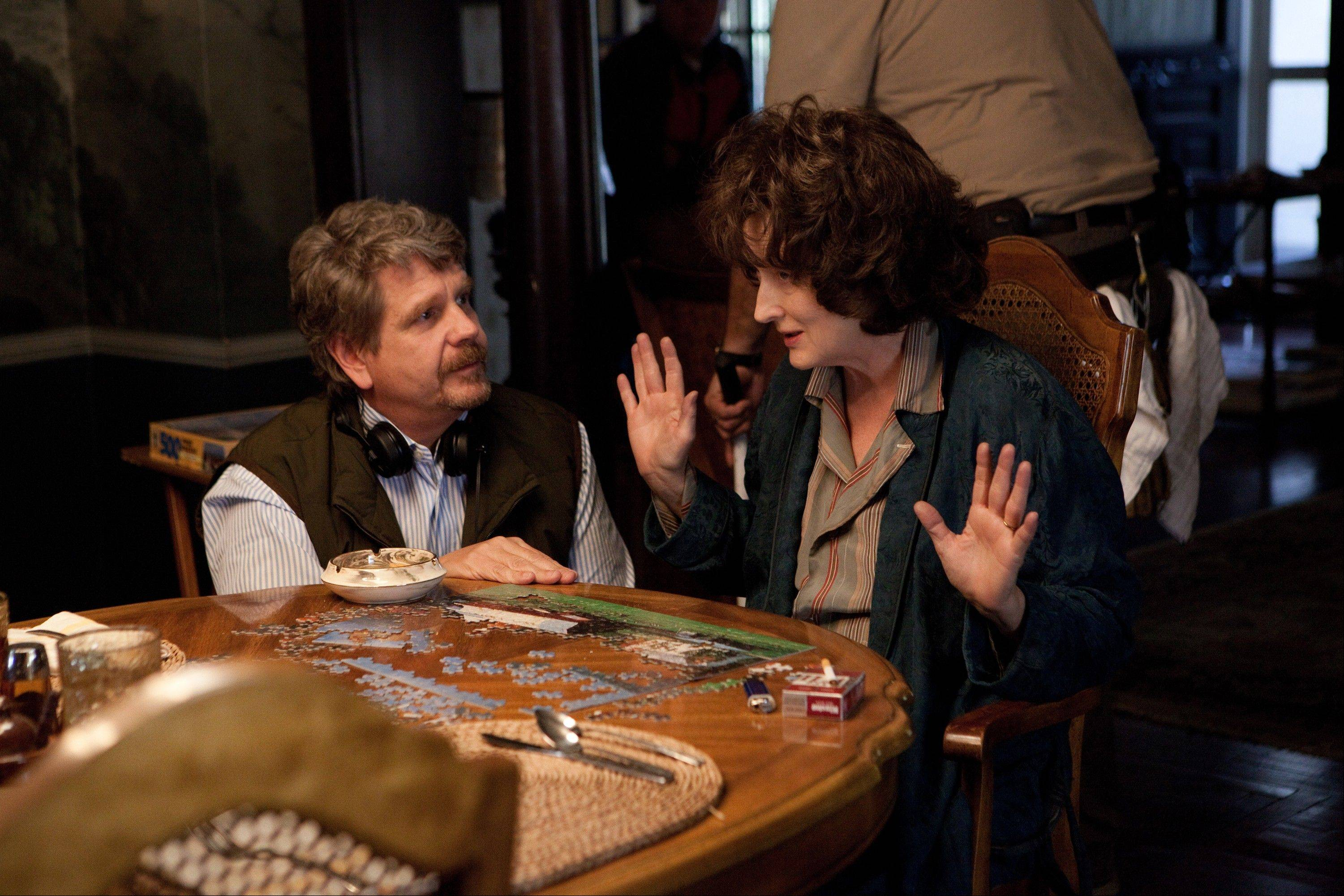 "John Wells, left, directs actress Meryl Streep during the filming of ""August: Osage County."" Streep was nominated for a Golden Globe for best actress in a motion picture musical or comedy for her role in the film."