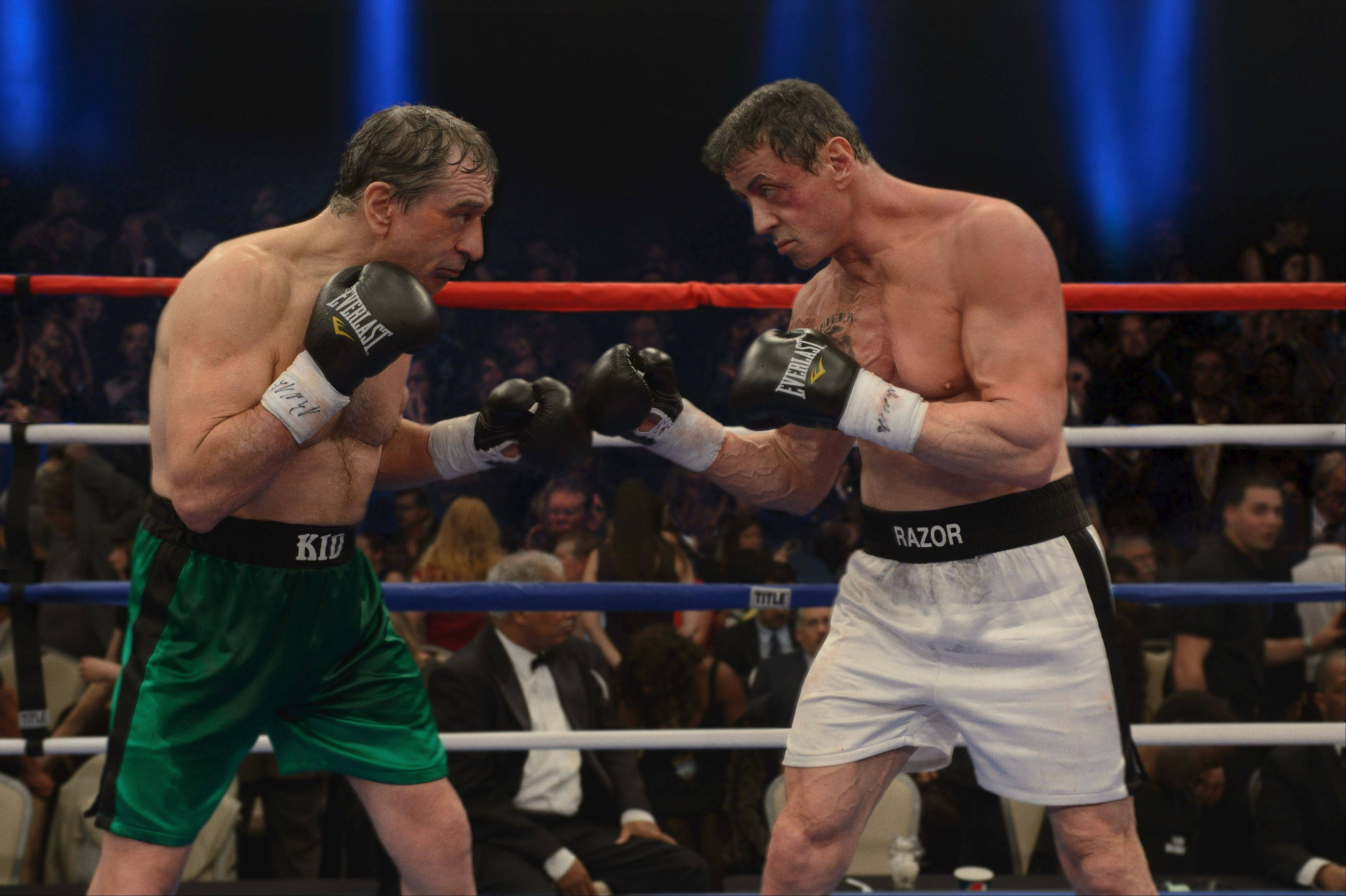 "Old boxing rivals Billy ""The Kid"" McDonnen (Robert De Niro), left, and Henry ""Razor"" Sharp (Sylvester Stallone) agree to a decades-delayed bout in ""Grudge Match."""