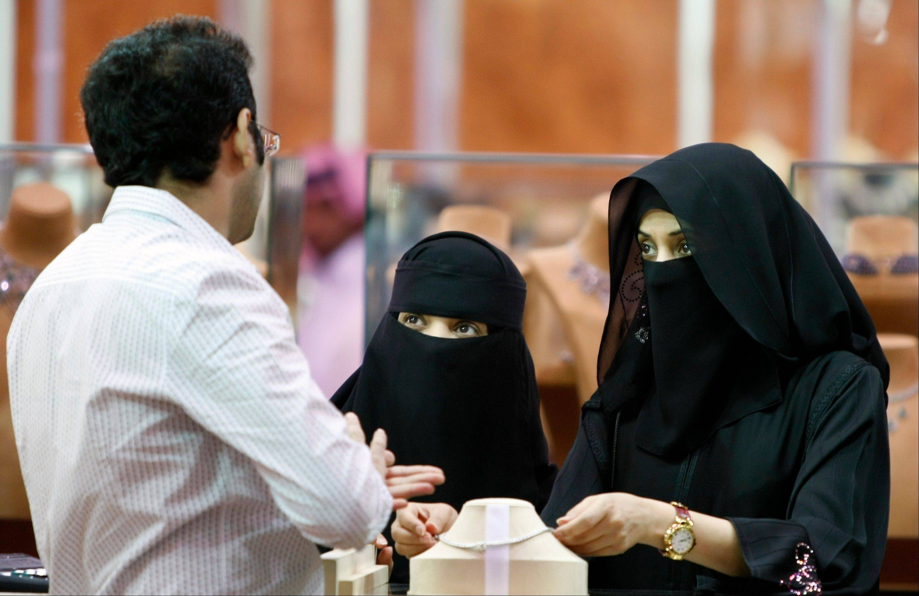 Saudi women look at jewelry at a gold fair in Riyadh, Saudi Arabia. With global attention focused on upheaval elsewhere in the Middle East, Saudi Arabia quietly intensified its clampdown on dissent in 2013.