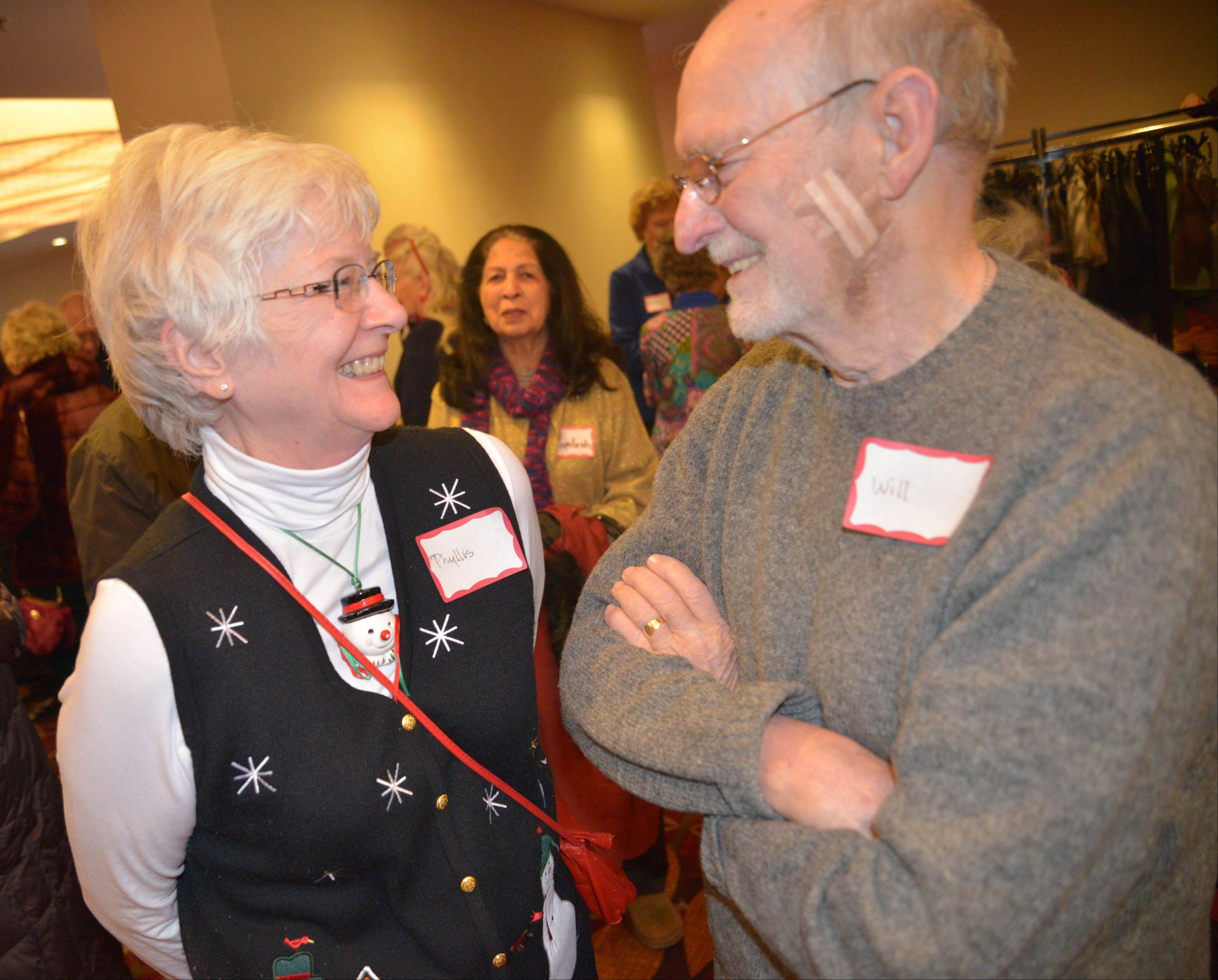 Phyllis and Will LaRiviere of Naperville are all smiles at the 30th annual Christmas senior luncheon, hosted by the Naperville Park District and Naperville YMCA, on Wednesday.