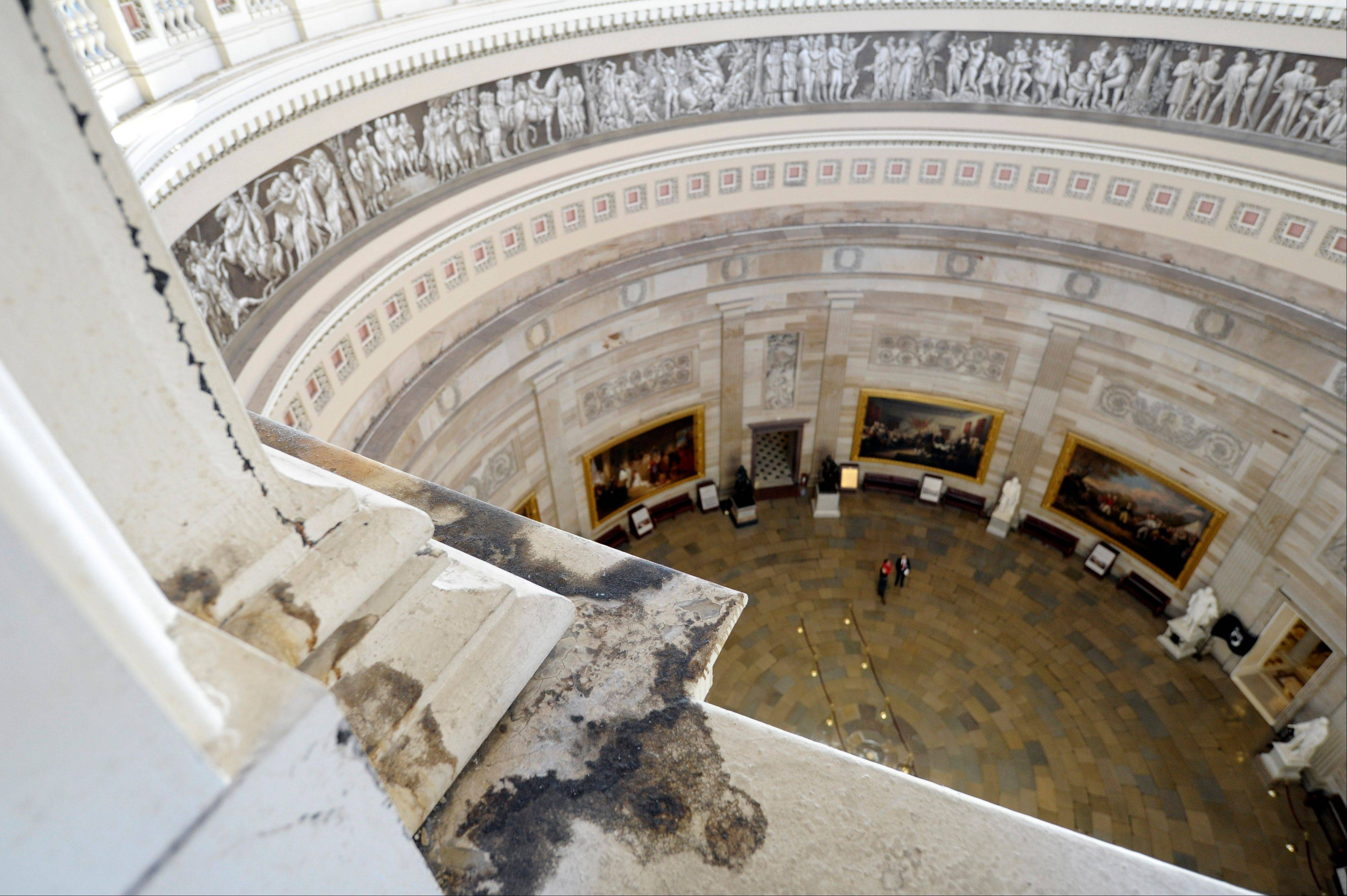 Water damage stains are visible on the inside of the Capitol Dome during a tour on Capitol Hill in Washington, Thursday, Dec. 19, 2013. Scaffolding will begin to cover the Capitol dome this spring when the $60 million restoration project begins. This is the first major renovation since 1960.