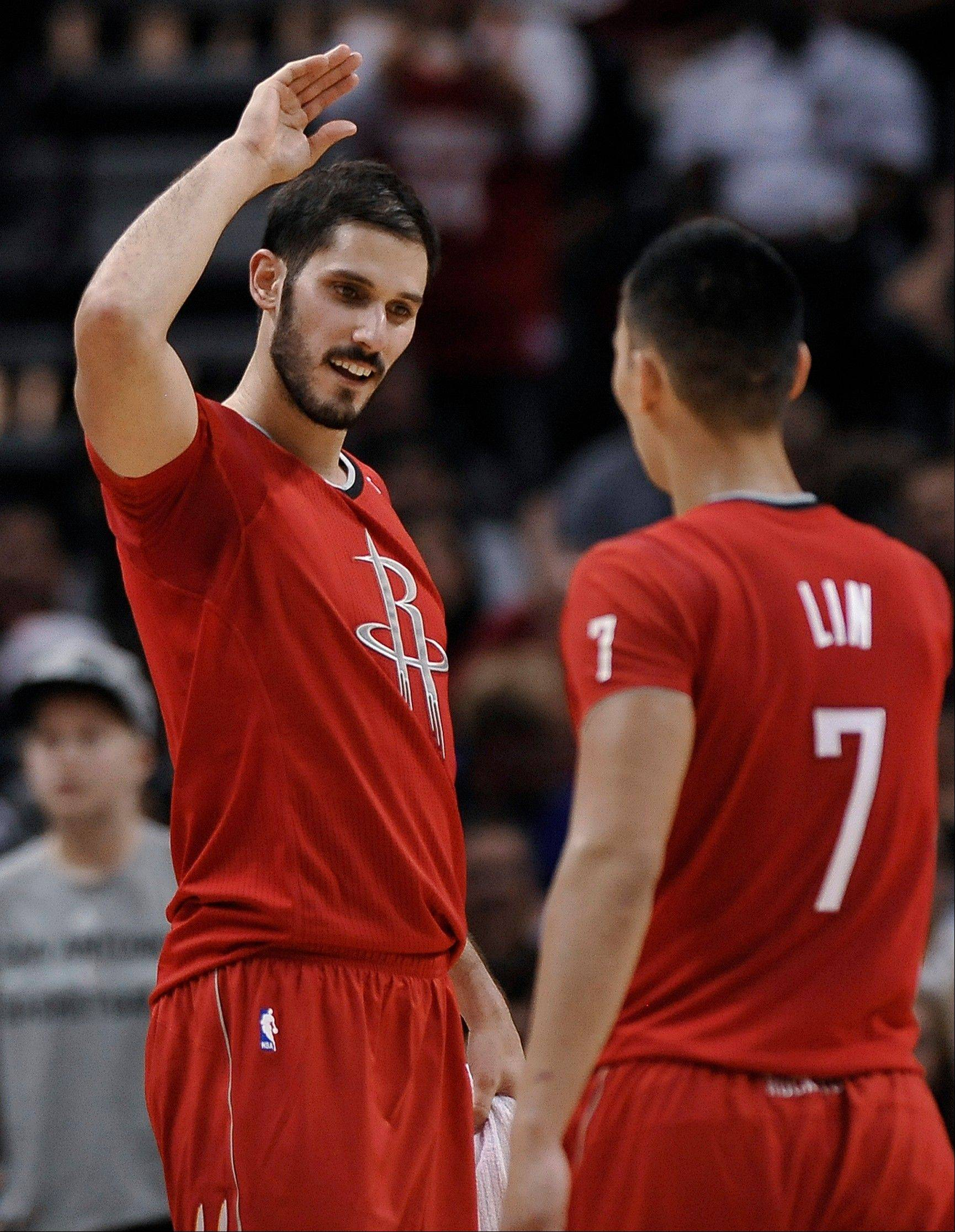 Houston Rockets forward Omri Casspi congratulates guard Jeremy Lin on a play during the second half of Wednesday�s road game against the San Antonio Spurs.