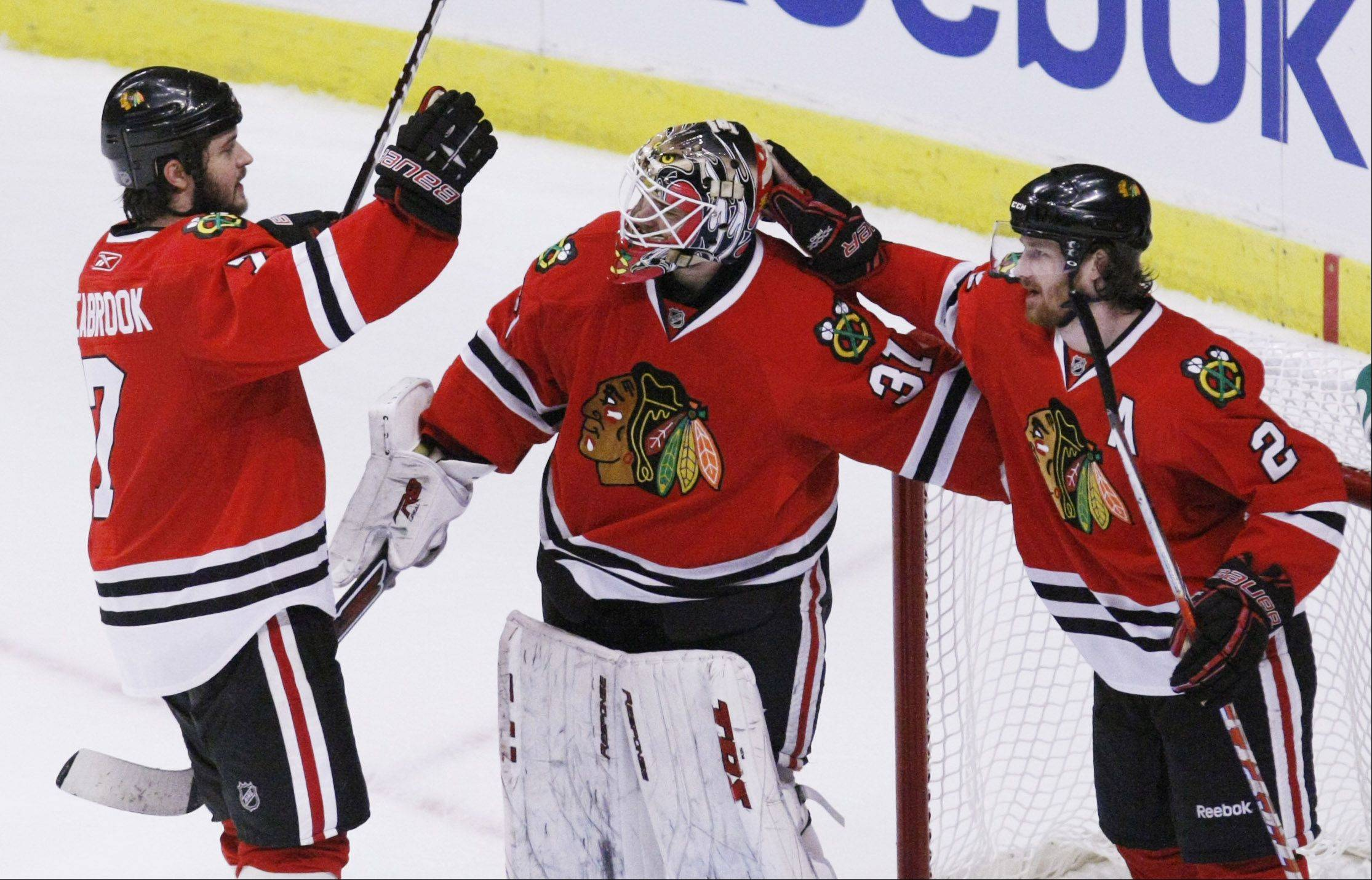 Blackhawks defenseman Brent Seabrook, left, and Duncan Keith, right celebrate with goalie Antti Niemi their 4-2 win over the San Jose Sharks in Game 4 of the NHL Western Conference finals Sunday, May 23, 2010 in Chicago. The Blackhawks swept the series 4-0.