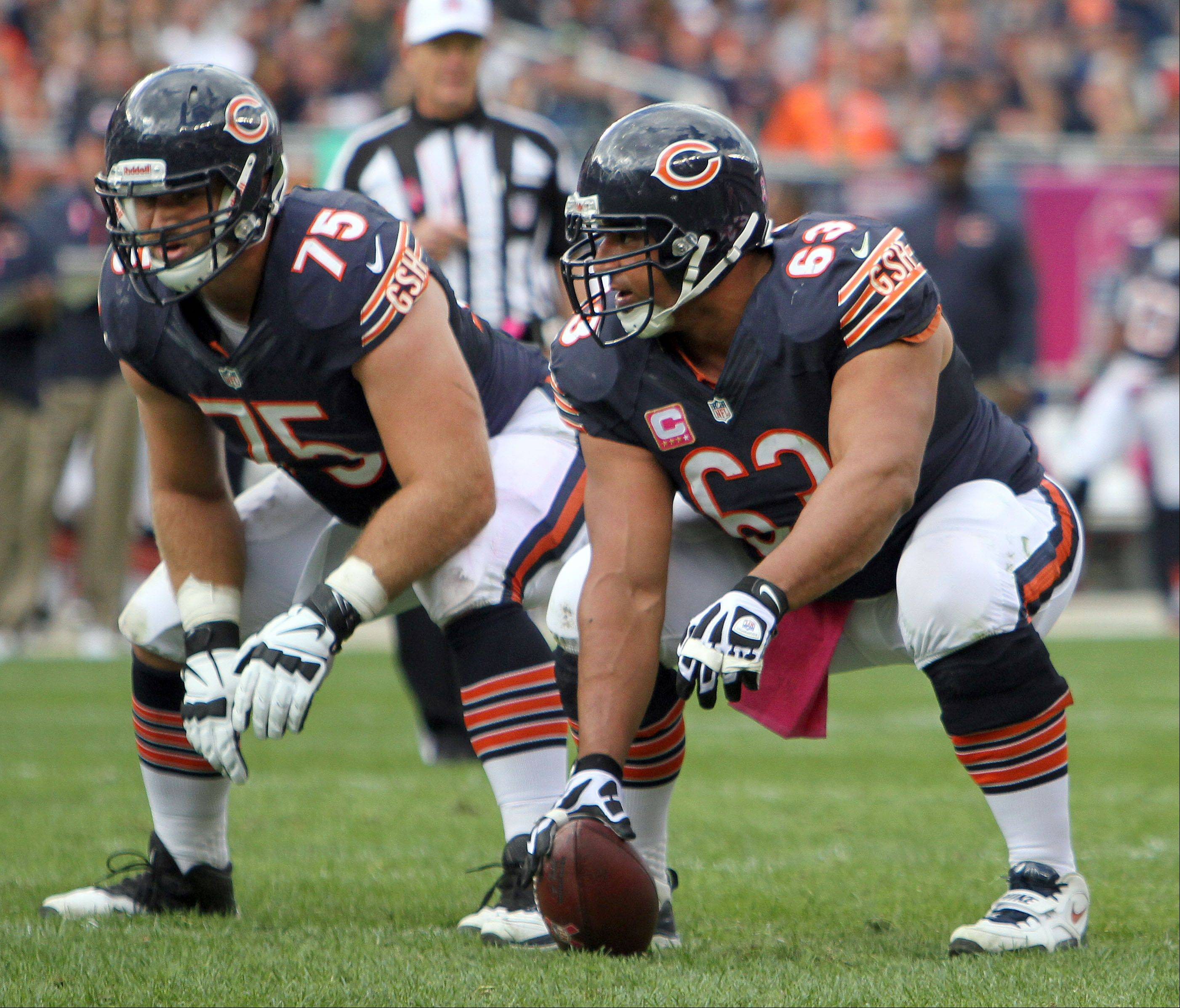 Center Roberto Garza, a 13-year veteran including the last nine with the Bears, has anchored an offensive line featuring the same five players starting in all 15 games this season — including rookie Kyle Long, left. The others, who are not pictured, are Jermon Bushrod, Matt Slauson and Jordan Mills.