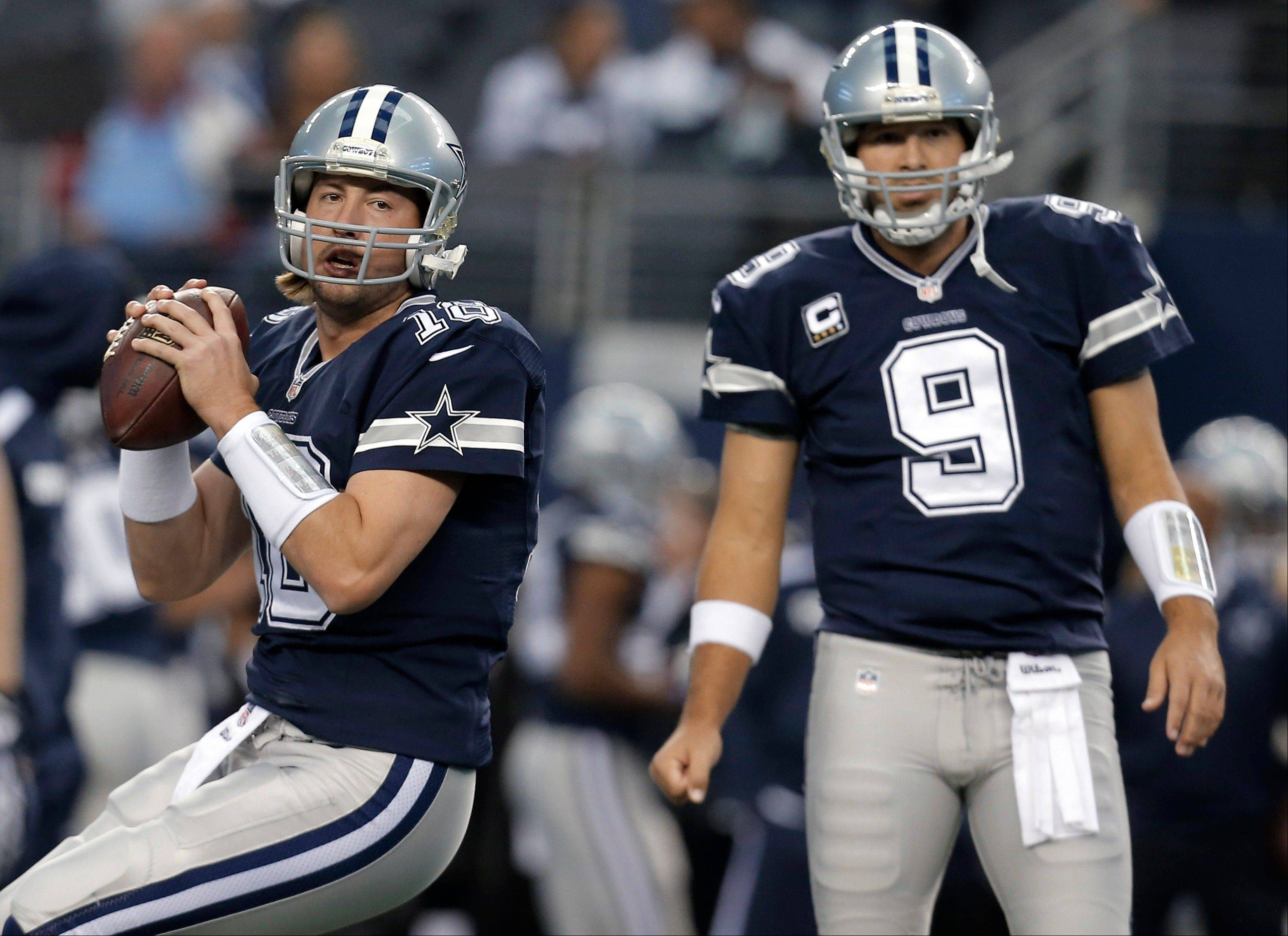 Dallas Cowboys quarterbacks Kyle Orton, left, and Tony Romo warm up for a game against the Oakland Raiders. Orton is expected to start Sunday night against Philadelphia.