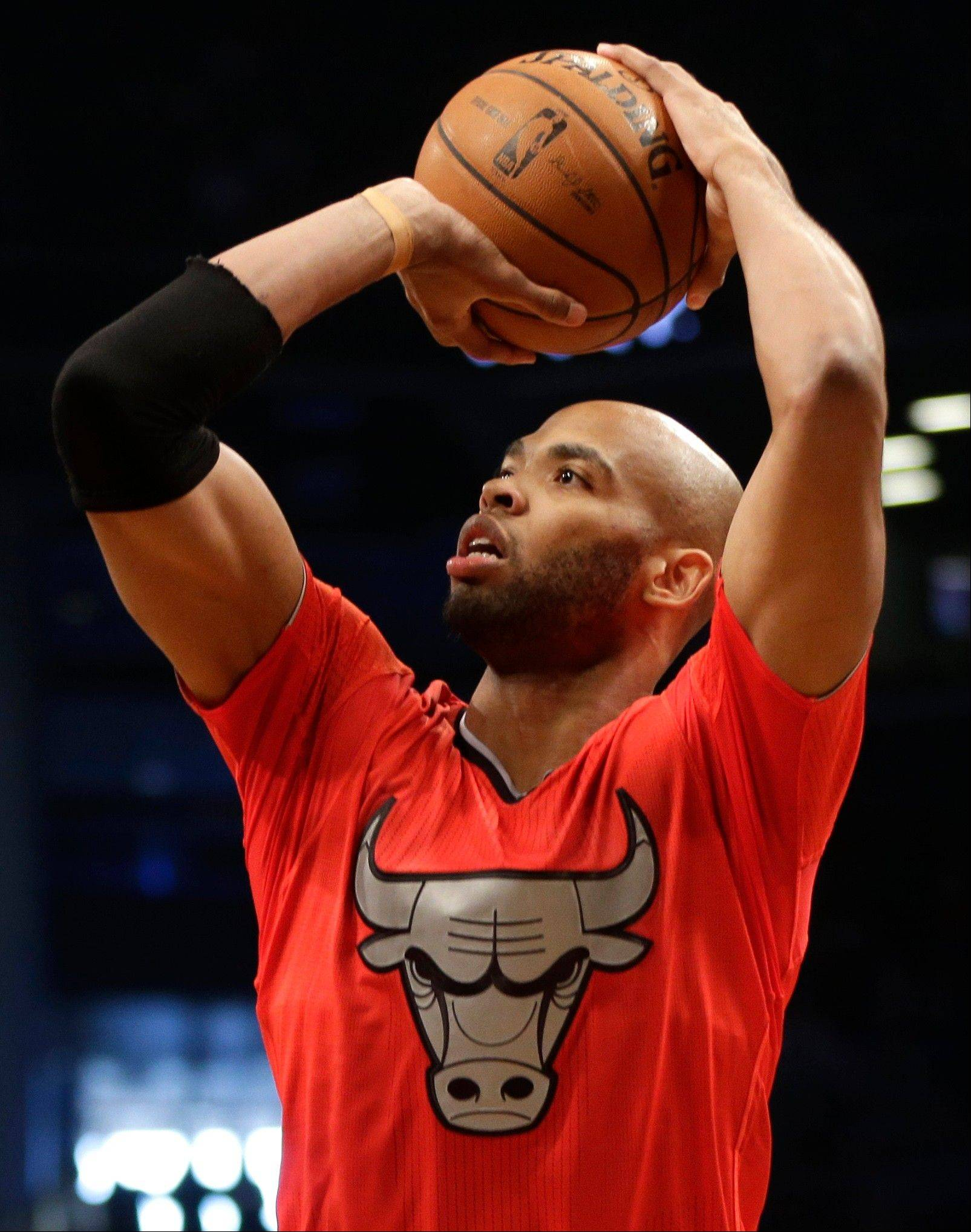 Chicago Bulls' Taj Gibson lines up a shot during the first half of the NBA basketball game against the Brooklyn Nets at the Barclays Center Wednesday in New York.