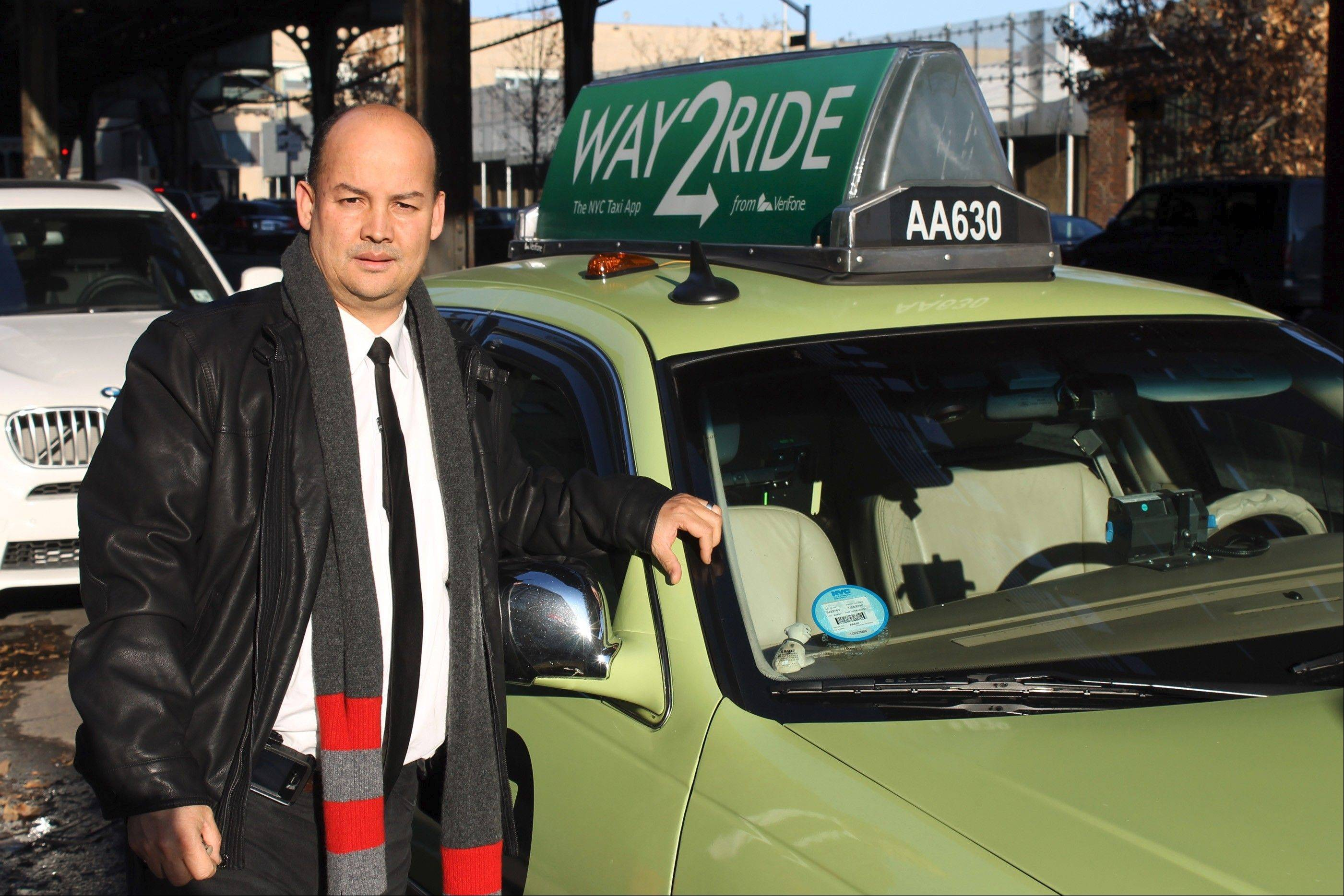 Taxi driver Porfirio Valdez of the Bronx with his 2006 Lincoln Town Car, which originally was black. The green paint job has almost doubled his income.