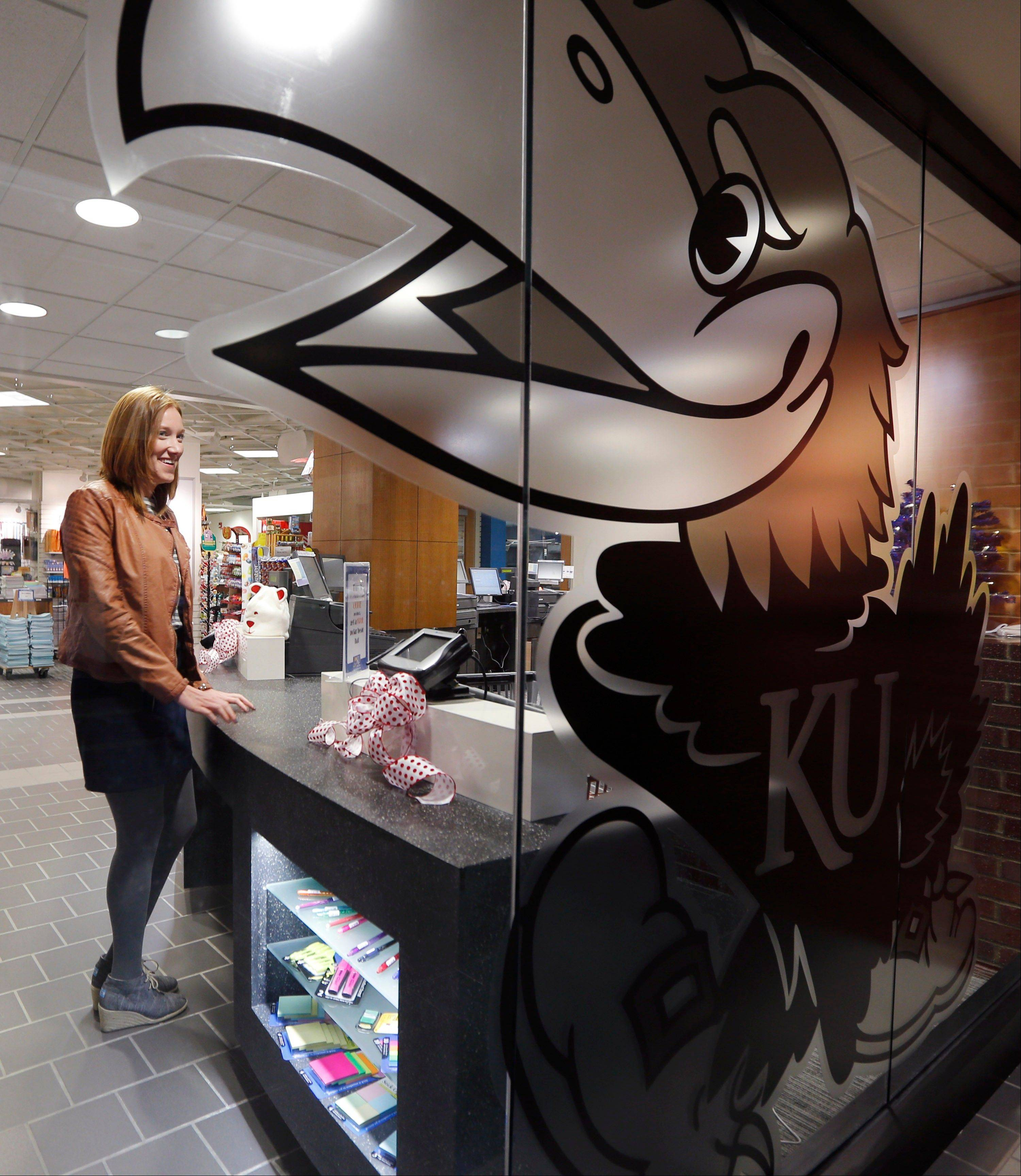TJane Mahoney stands at a counter in the KU Bookstore on the University of Kansas campus in Lawrence, Kansas. About 320 colleges and universities offered tuition guarantees during the 2012-13 school year, according to an analysis of U.S. Department of Education data done by the National Association of Student Financial Aid Administrators. The schools represent about 6.7 percent of the nation's nearly 4,800 institutions where students receive federal financial aid. Tuition rates for freshmen are guaranteed for four years at Kansas.
