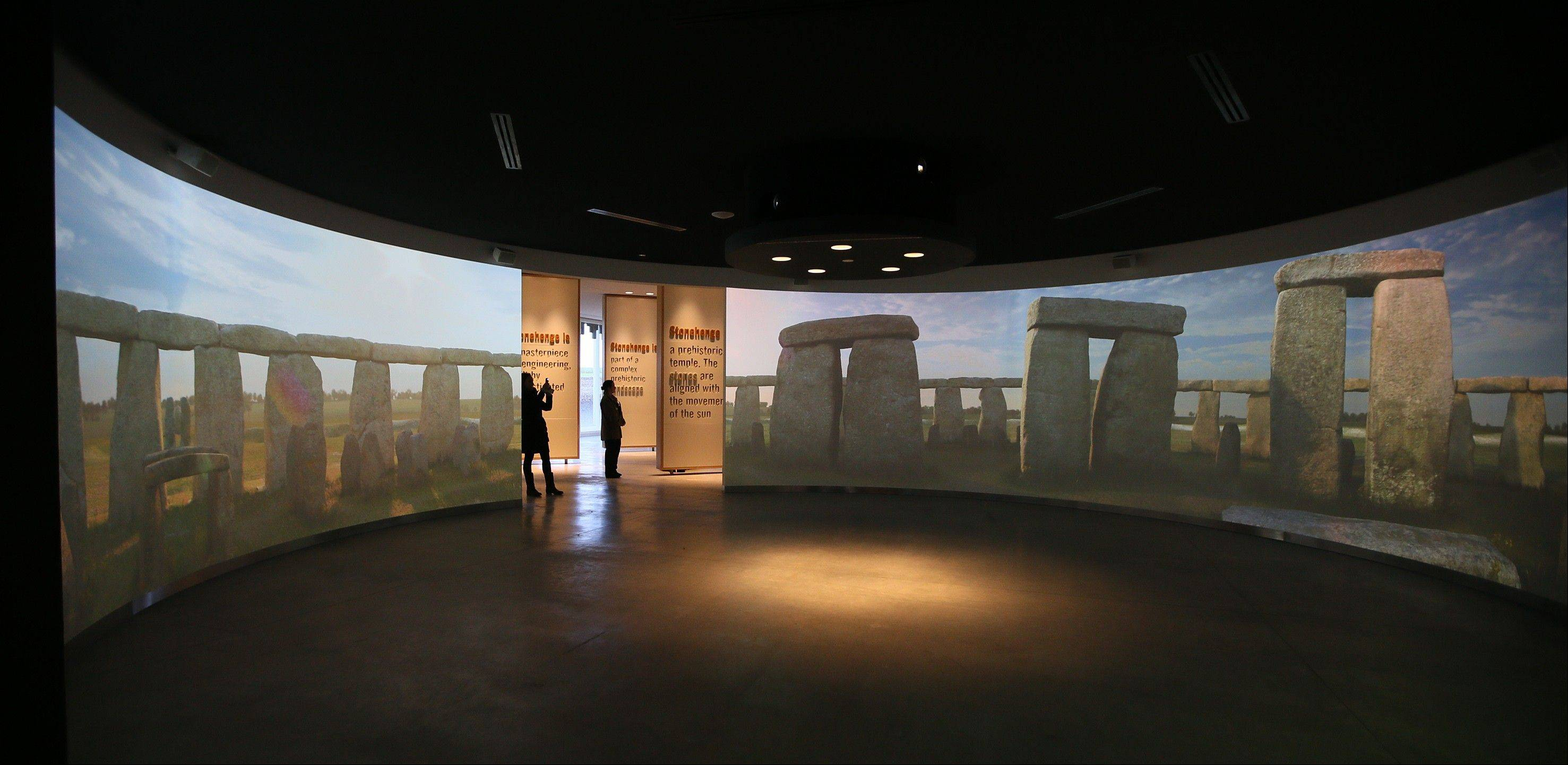 Visitors look at the audiovisual exhibits in a new building about 1.5 miles from Stonehenge.