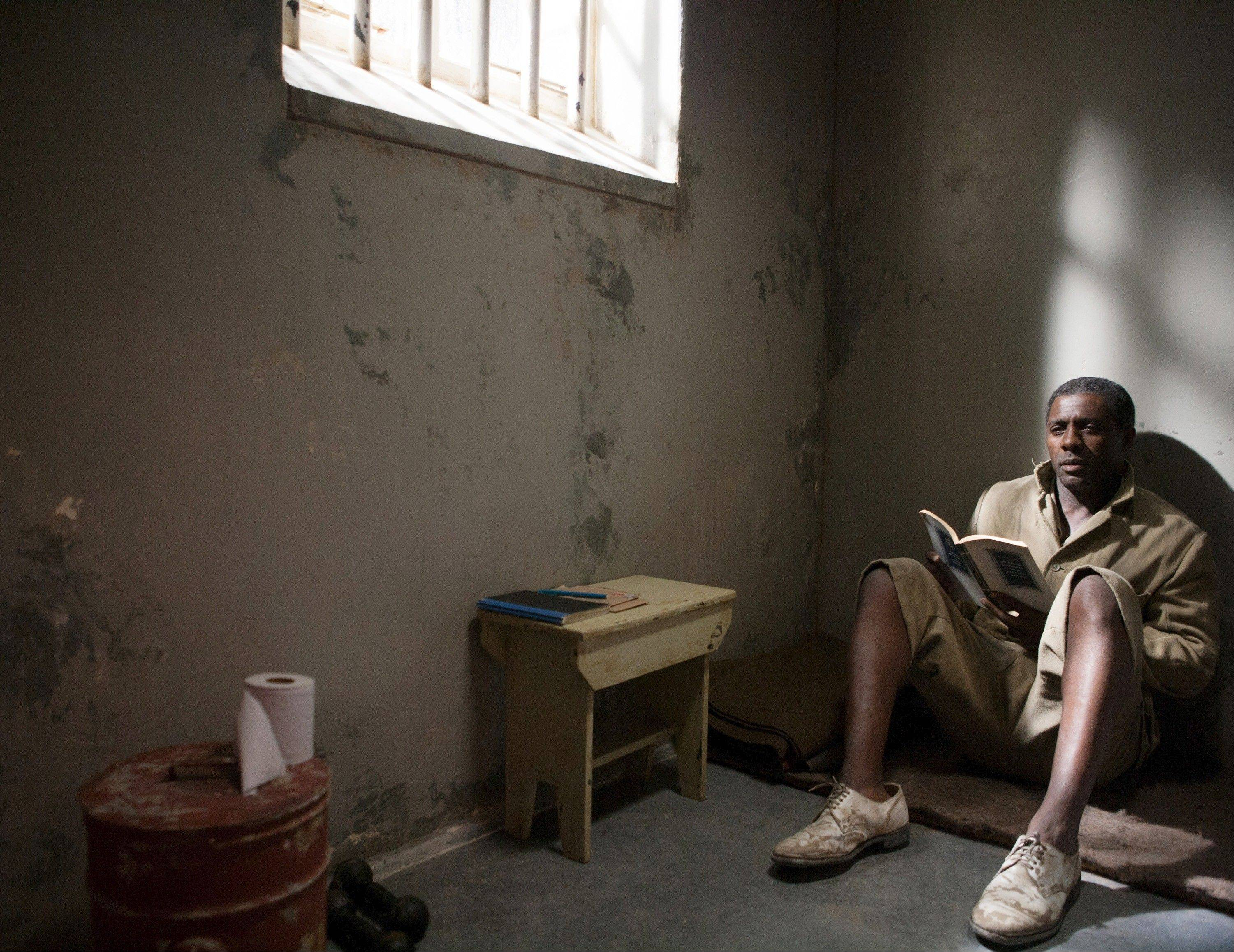 "Nelson Mandela (Idris Elba) waits in a South African jail for 27 years in the face-based drama ""Mandela: Long Walk to Freedom."""