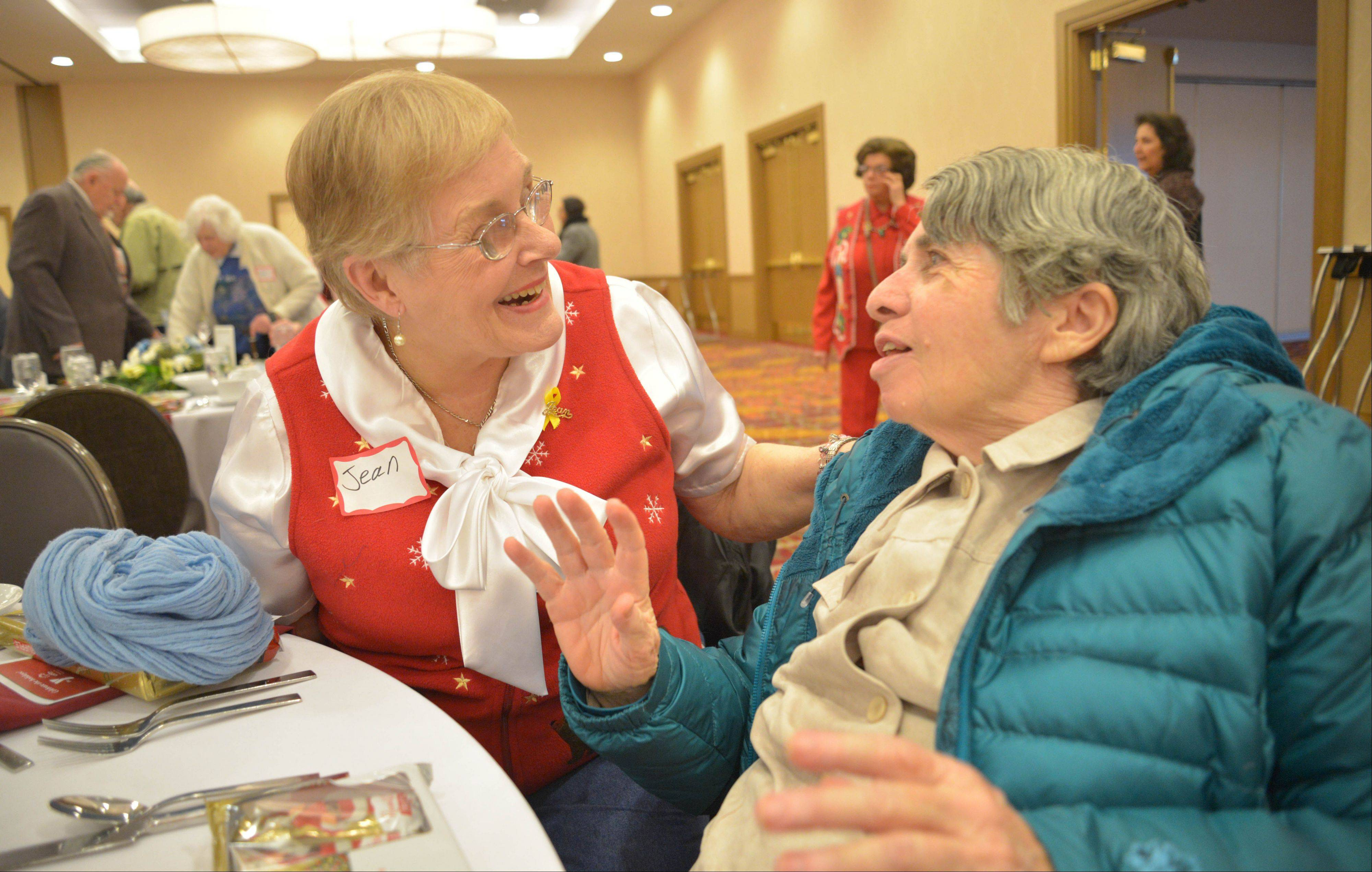 Jean Lundquist of Aurora, left, and Alice Glavin of Naperville chat over lunch Wednesday at the Marriott in Naperville.