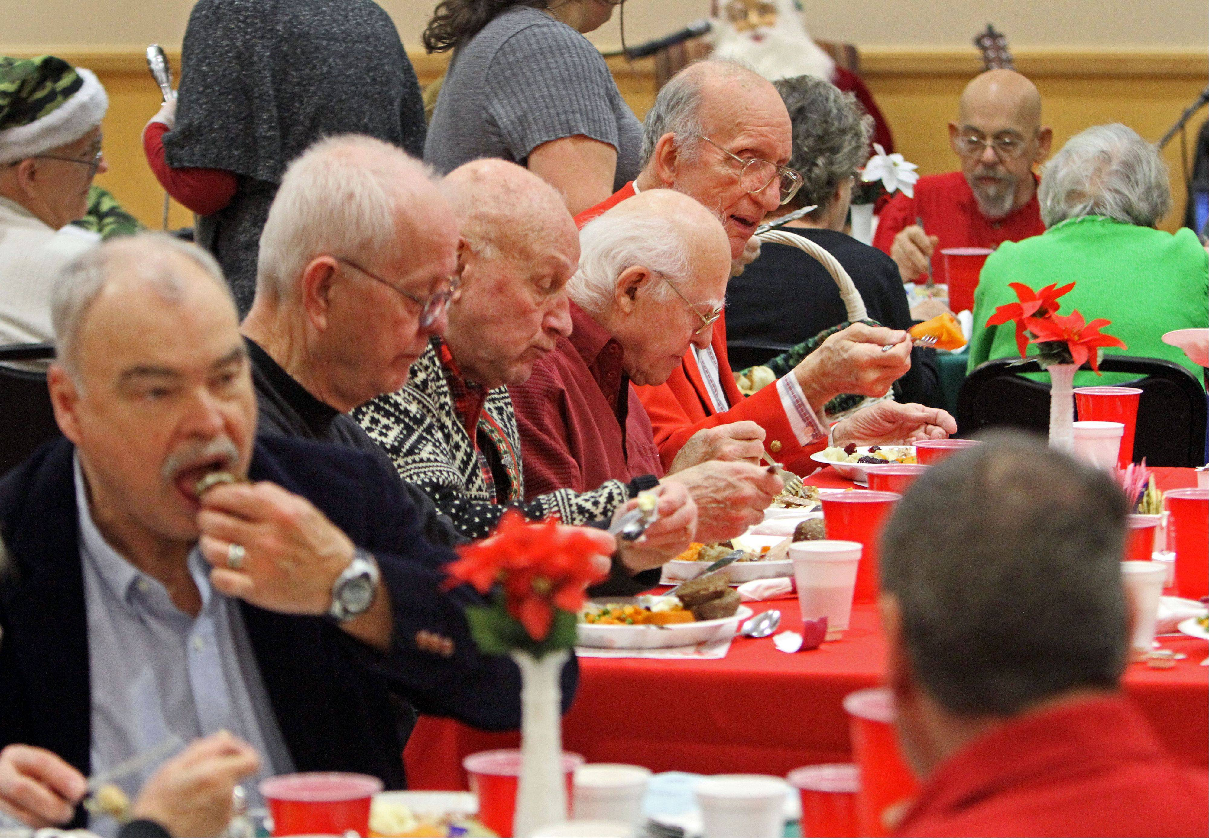 About 100 seniors were treated to Christmas dinner at the Frisbie Senior Center in Des Plaines Wednesday.