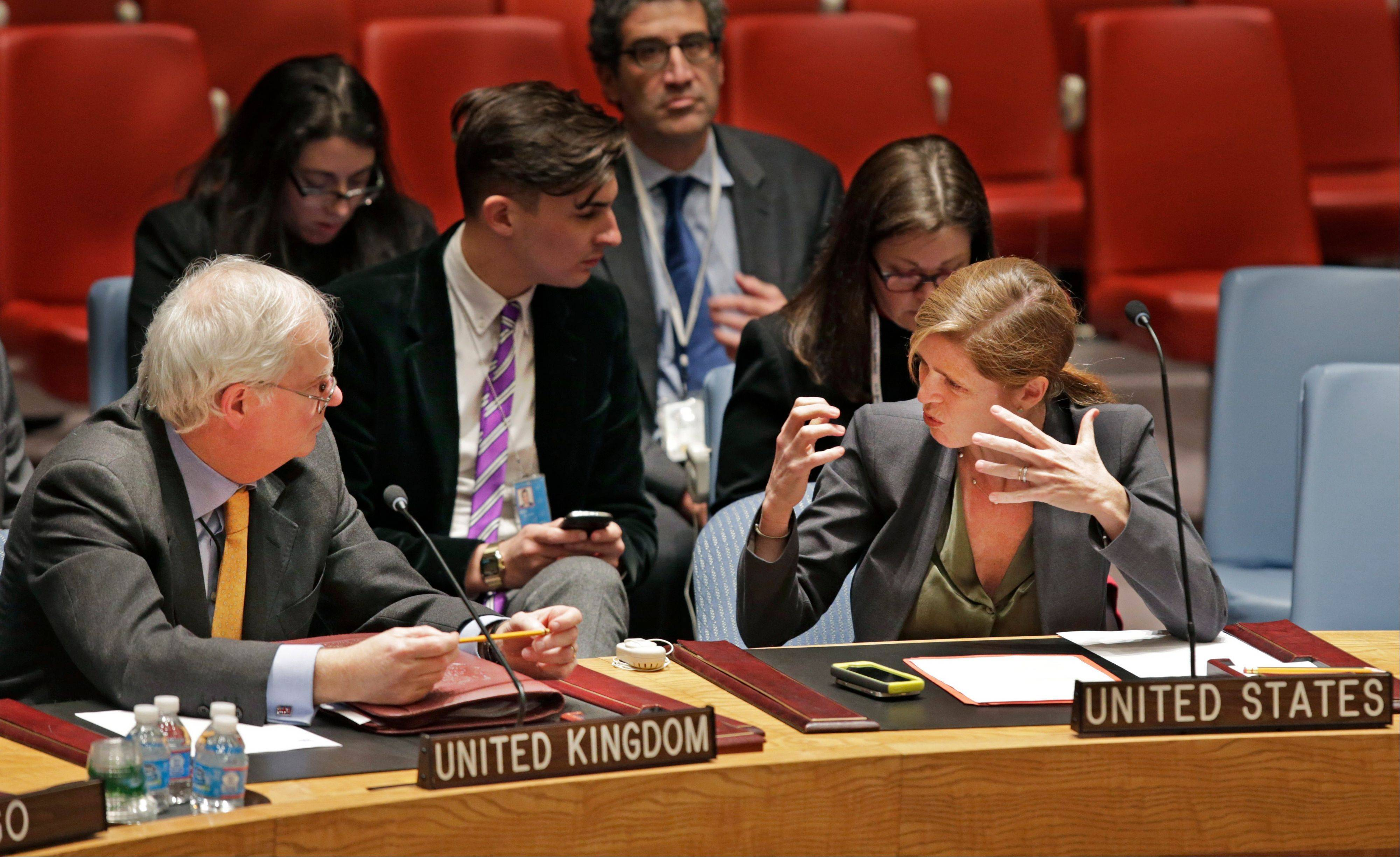 Great Britain's U.N. Ambassador Mark Lyall Grant, left, listens to Samantha Power, the United States U.N. Ambassador, before a United Nations Security Council meeting Tuesday at U.N. headquarters.