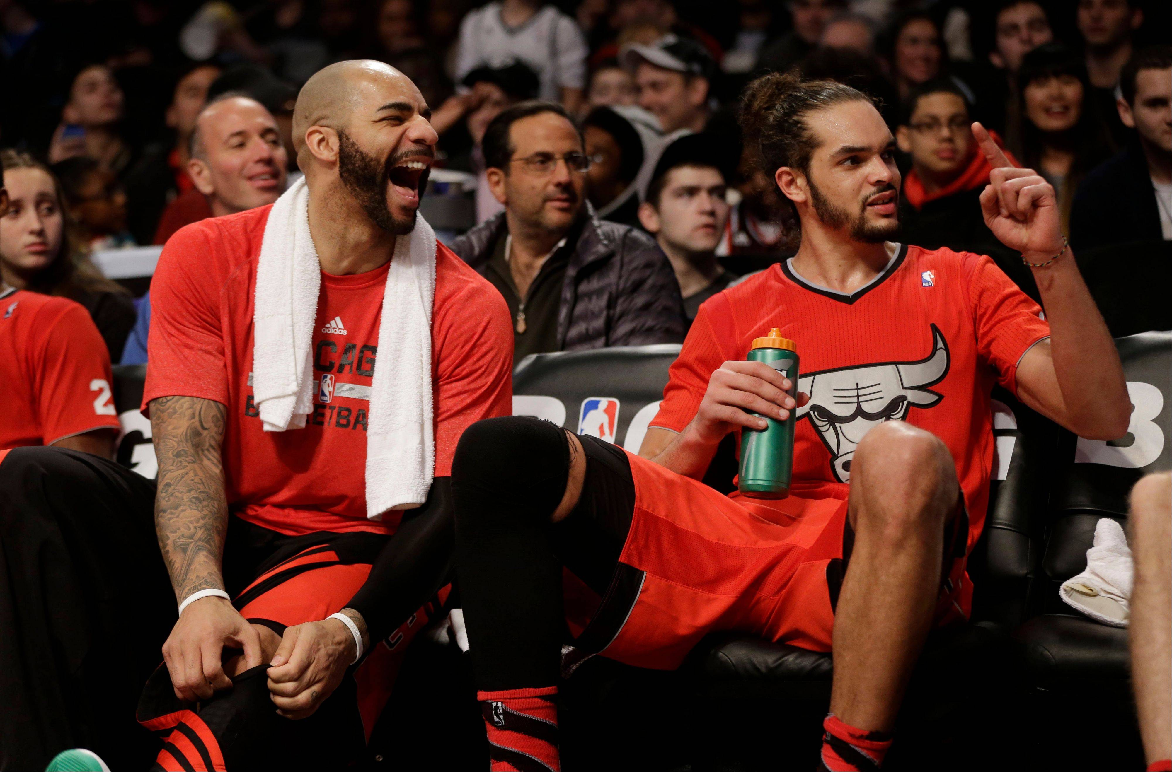 Chicago Bulls' Carlos Boozer, left, and Joakim Noah relax on the bench near the end of the second half of the NBA basketball game against the Brooklyn Nets at the Barclays Center Wednesday in New York. The Bulls defeated the Nets 95-78.