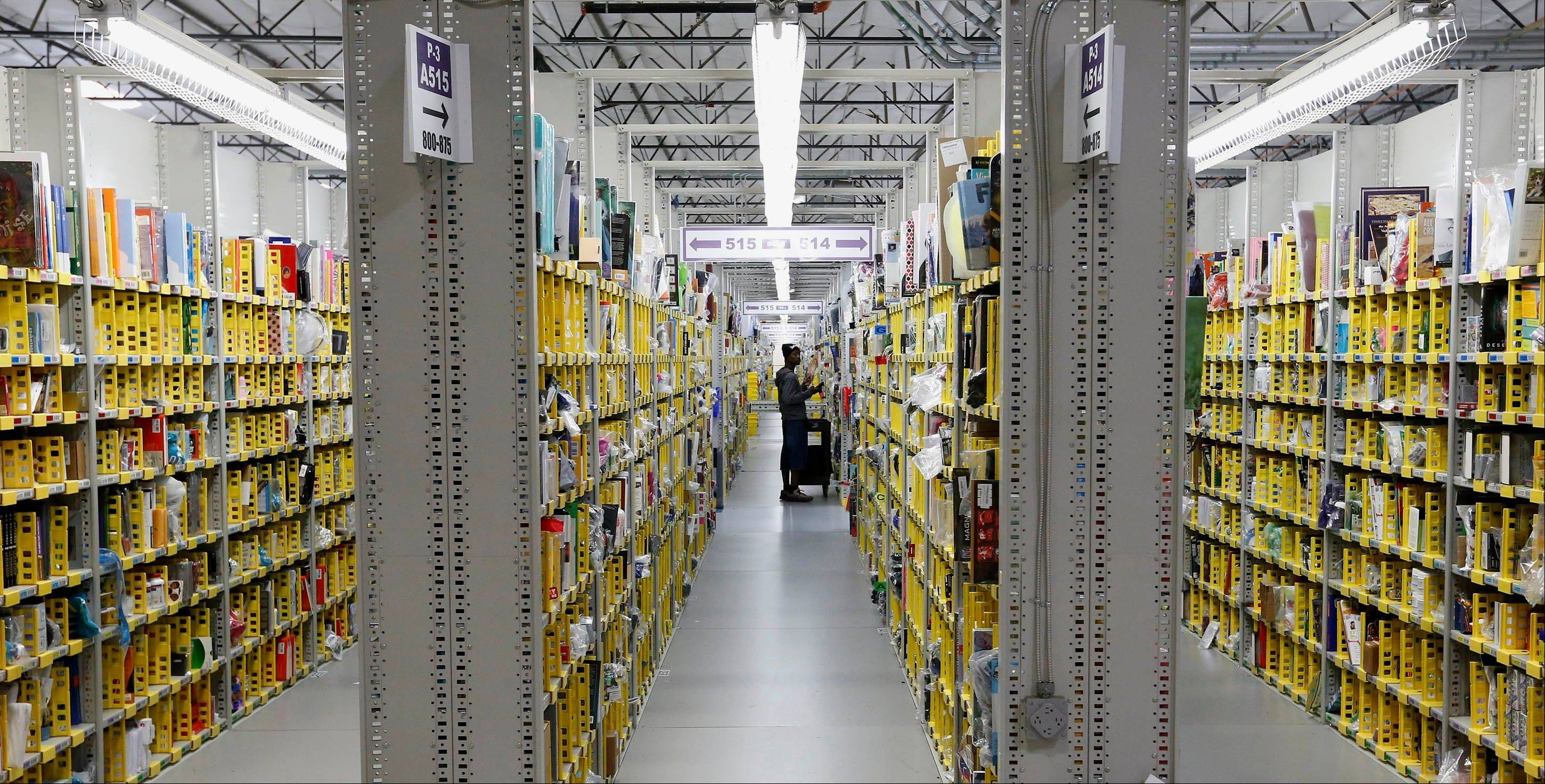 An Amazon.com employee stocks a shelf at an Amazon.com Fulfillment Center on �Cyber Monday.� Shoppers waited until the last possible minute to buy presents this year, even online. The late surge sent holiday retail sales up 3.5 percent, which ultimately was good news for retailers but caught shippers UPS and FedEx unprepared.