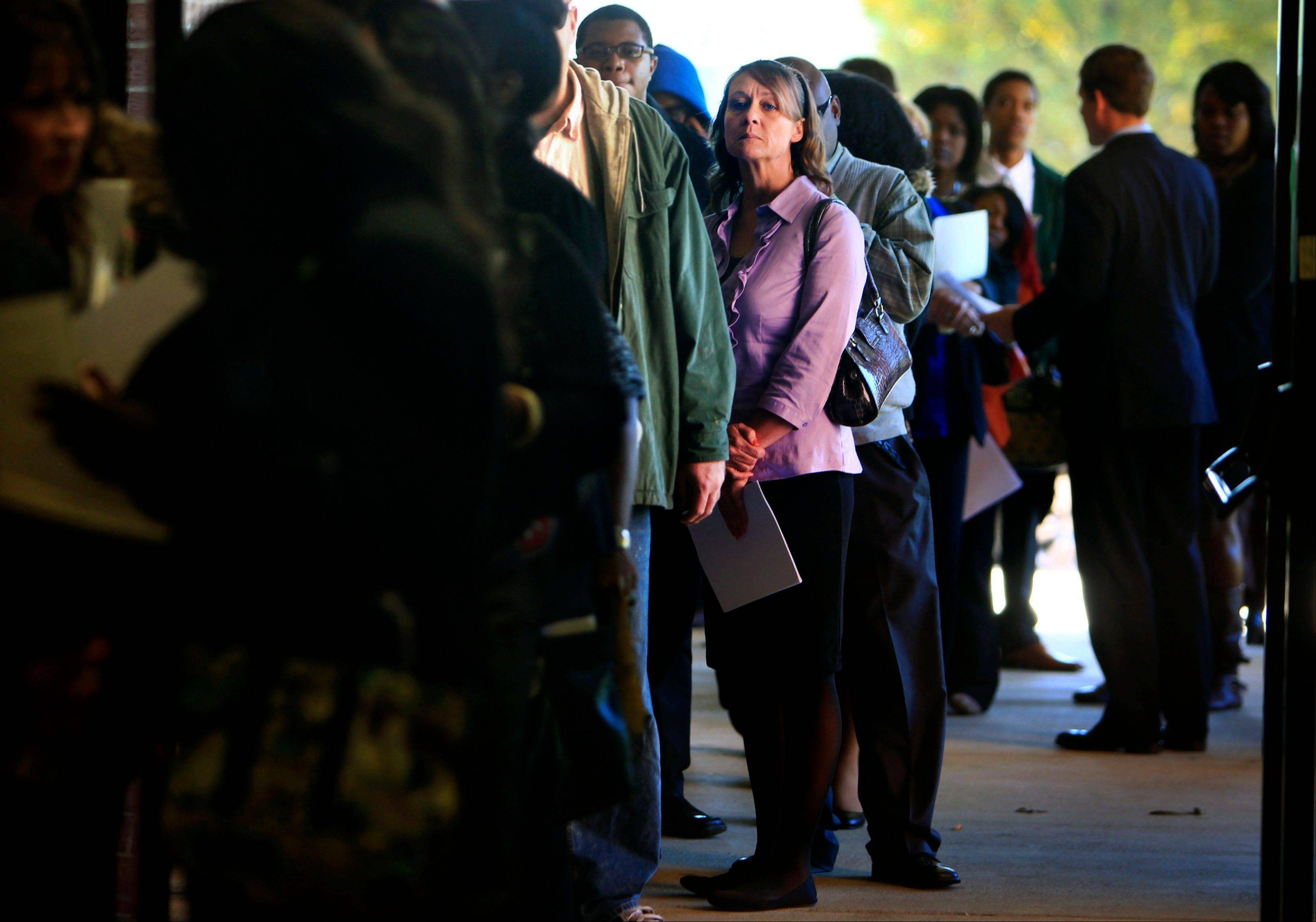 Jona Caldwell joins a long line of job seekers outside the Ferguson Community Center in Cordova, Tenn.