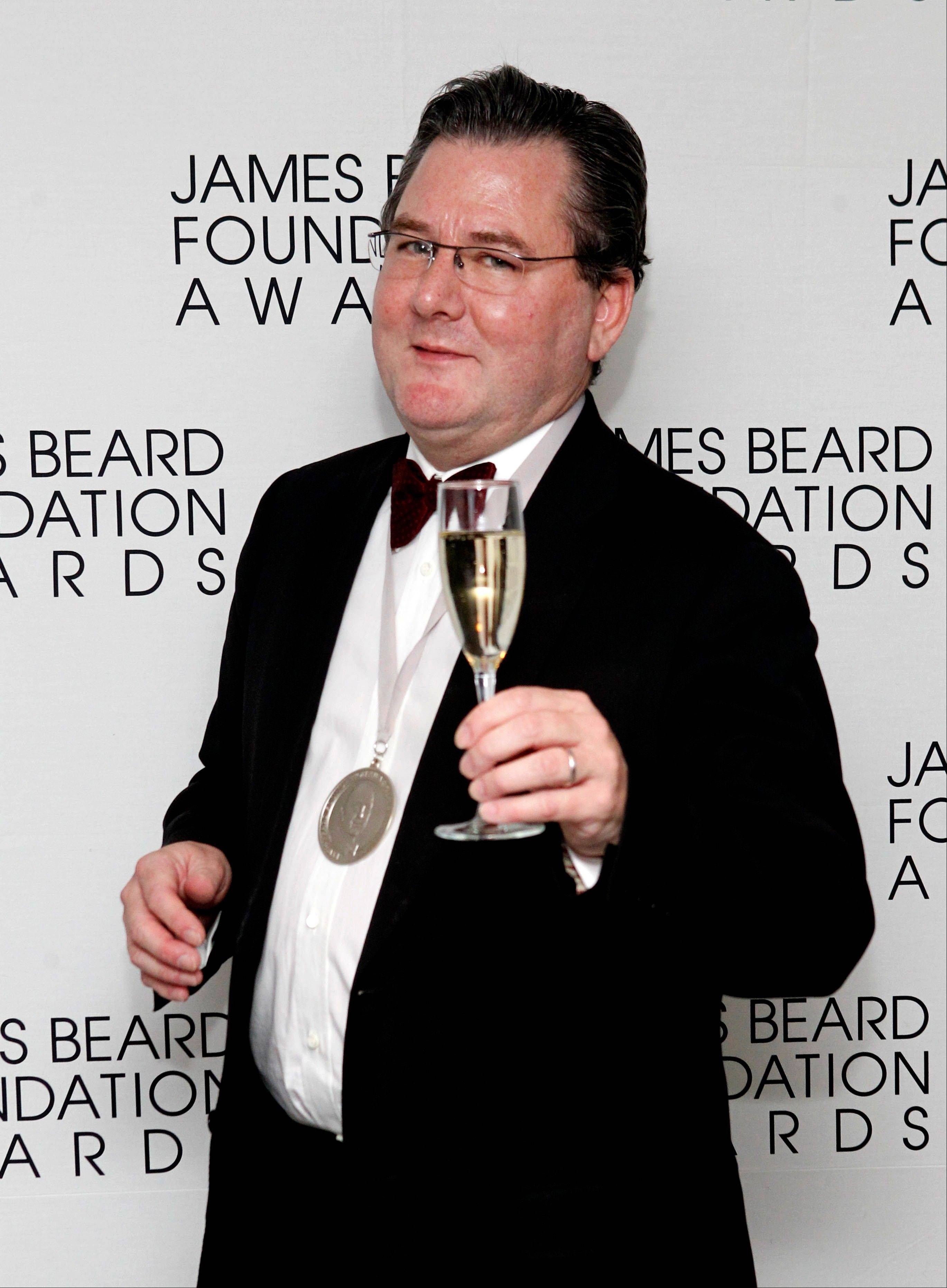 In this May 7, 2012 file photo, chef Charlie Trotter poses with a glass of champagne and his medal for Humanitarian of the Year during the James Beard Foundation Awards in New York. The award-winning chef died in November, a year after closing his eponymous Chicago restaurant that is credited with elevating the city�s cuisine and providing a training ground for some of the nation�s other best chefs.