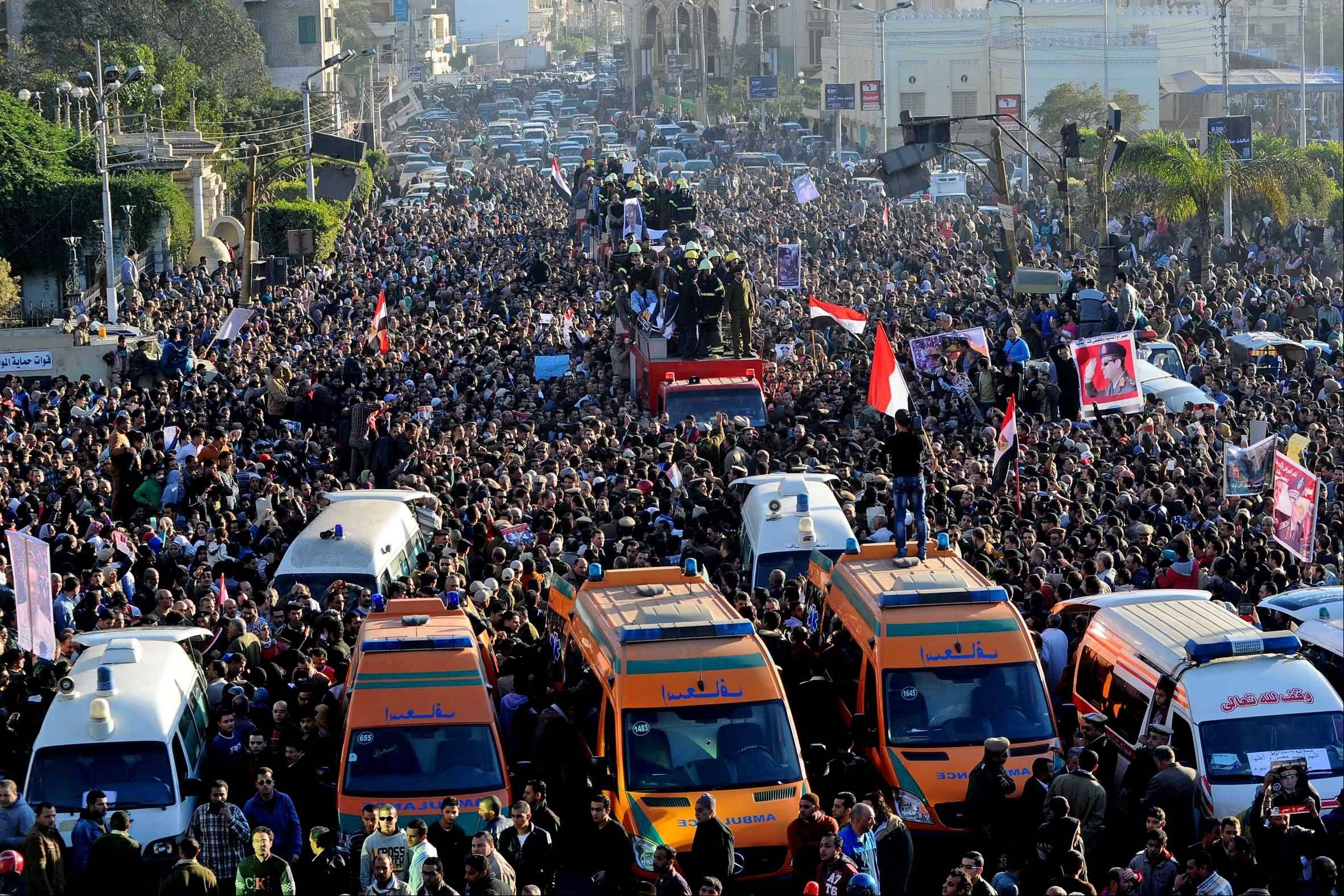 Egyptians on Tuesday attend the funeral of a dozen police officers and a civilian killed from an explosion at a police headquarters, in the Nile Delta city of Mansoura, 110 kilometers (70 miles) north of Cairo, Egypt. Egypt�s security authorities warned Thursday that their forces will take an even tougher line on protests by the Muslim Brotherhood.