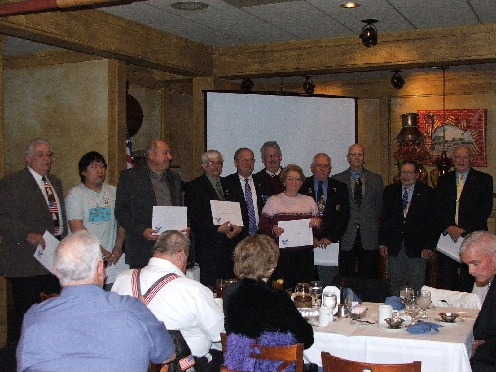 VAC volunteers with over 500 hours receiving the President Gold Pin with letter from President Obama, left to right, Bernard J. Voit, Richard Moy, Stan Villarreal, Mike Kozar, Tom Marciciak, Bob Cloud, Arlene Lolly, Nicholas Konz, Al Lynch, Norm Arnswald and Richard Johnson.
