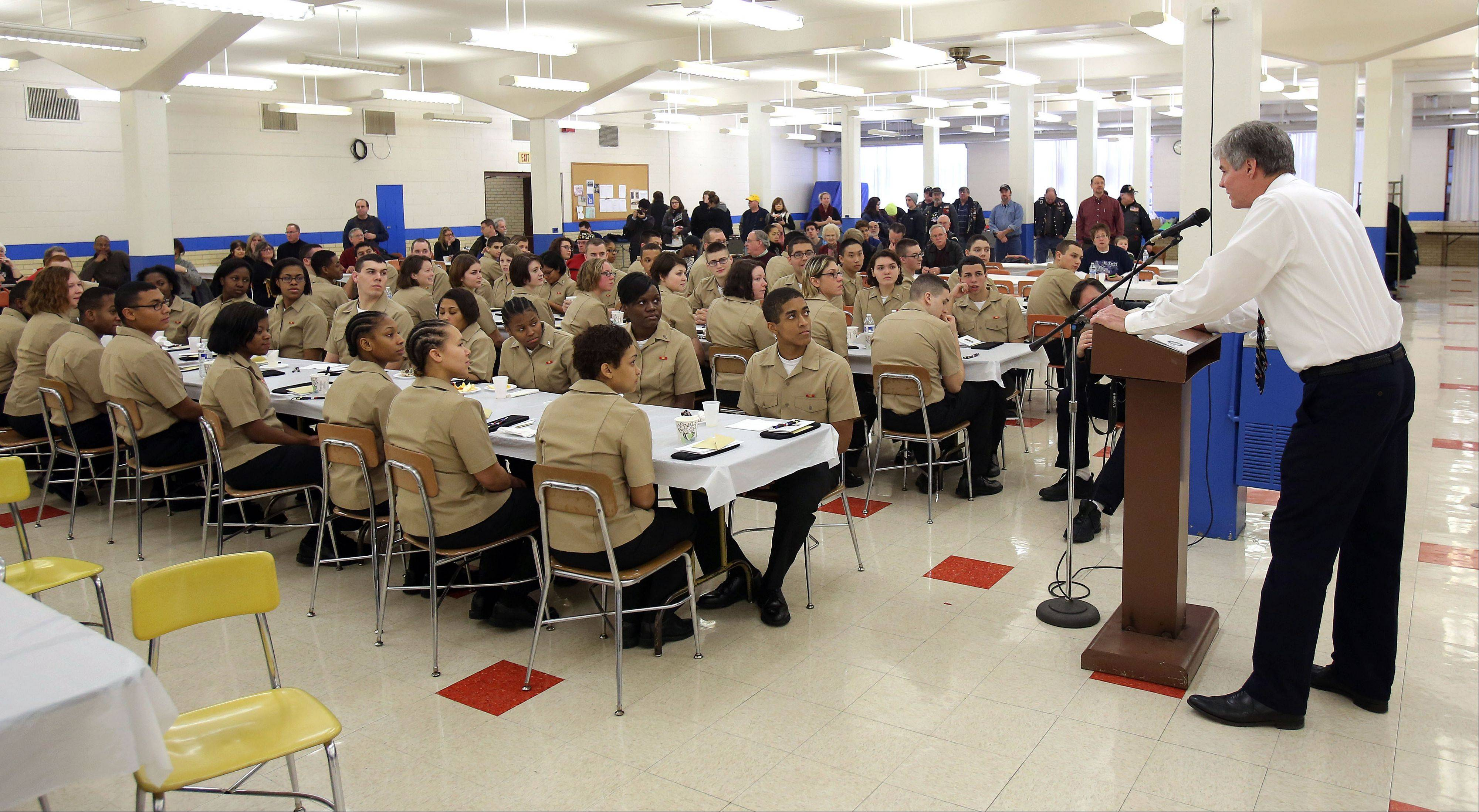 Robert Stack of Arlington Heights addresses about 50 recruits from Great Lakes Naval Base during a Christmas event at Christian Liberty Academy in Arlington Heights Wednesday morning. Stack lost his son, Marine Lance Cpl. James Bray Stack, in Afghanistan in 2010.