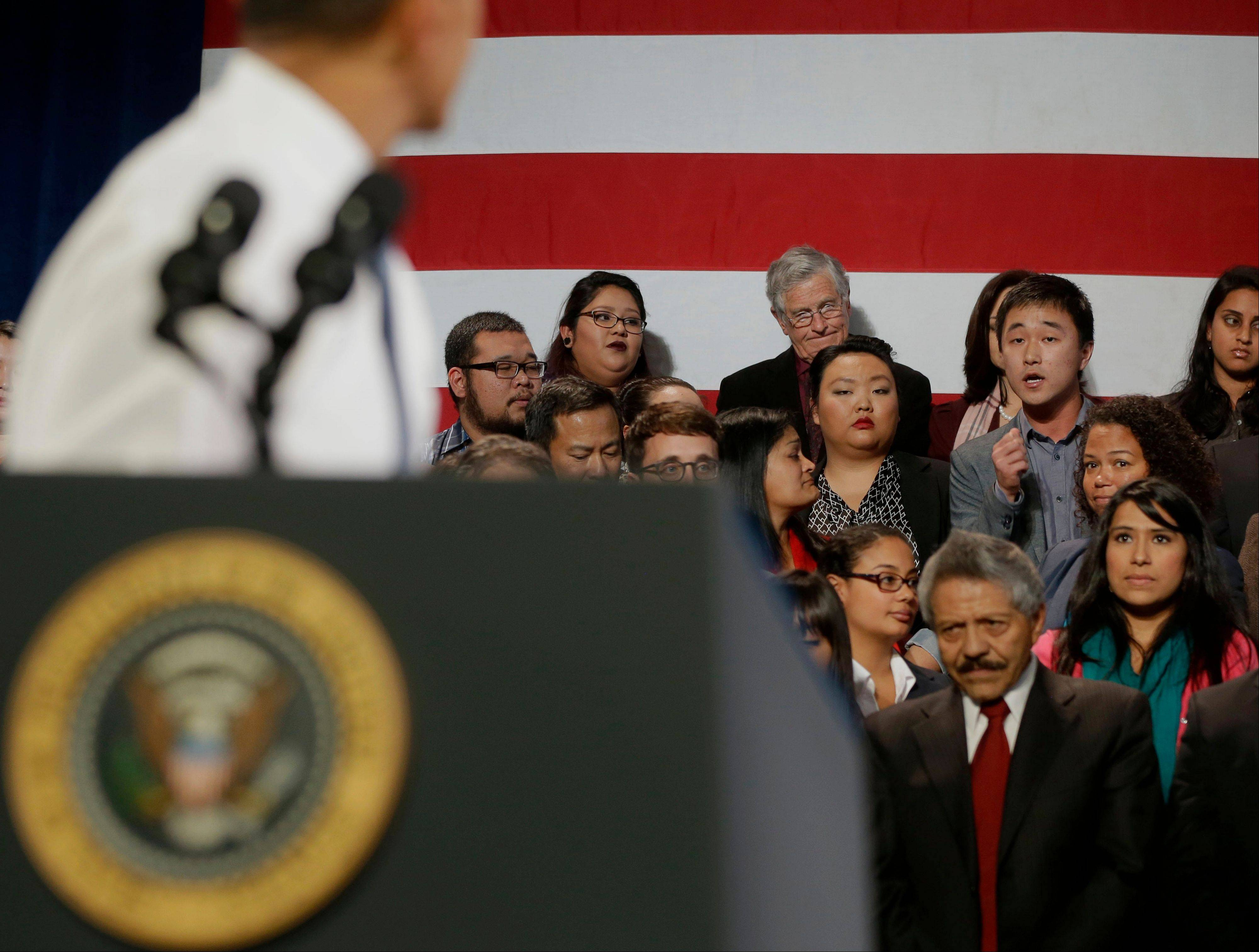 President Barack Obama, left, stops and turns to respond to Ju Hong who heckled him about anti-deportation policies at the Betty Ann Ong Chinese Recreation Center in San Francisco on Monday, Nov. 25, 2013. Obama stopped his speech about immigration reform to let Hong, who was located directly behind Obama, speak and to respond to his questions. South Koreans were delighted when Obama asked the young Korean heckler to stay, rather than ordering him removed. �I wish we had that kind of president who listens to the opinions of the minority,� says Kim Jin-hwan, a 32-year-old baker from Seoul. �I was very jealous.�