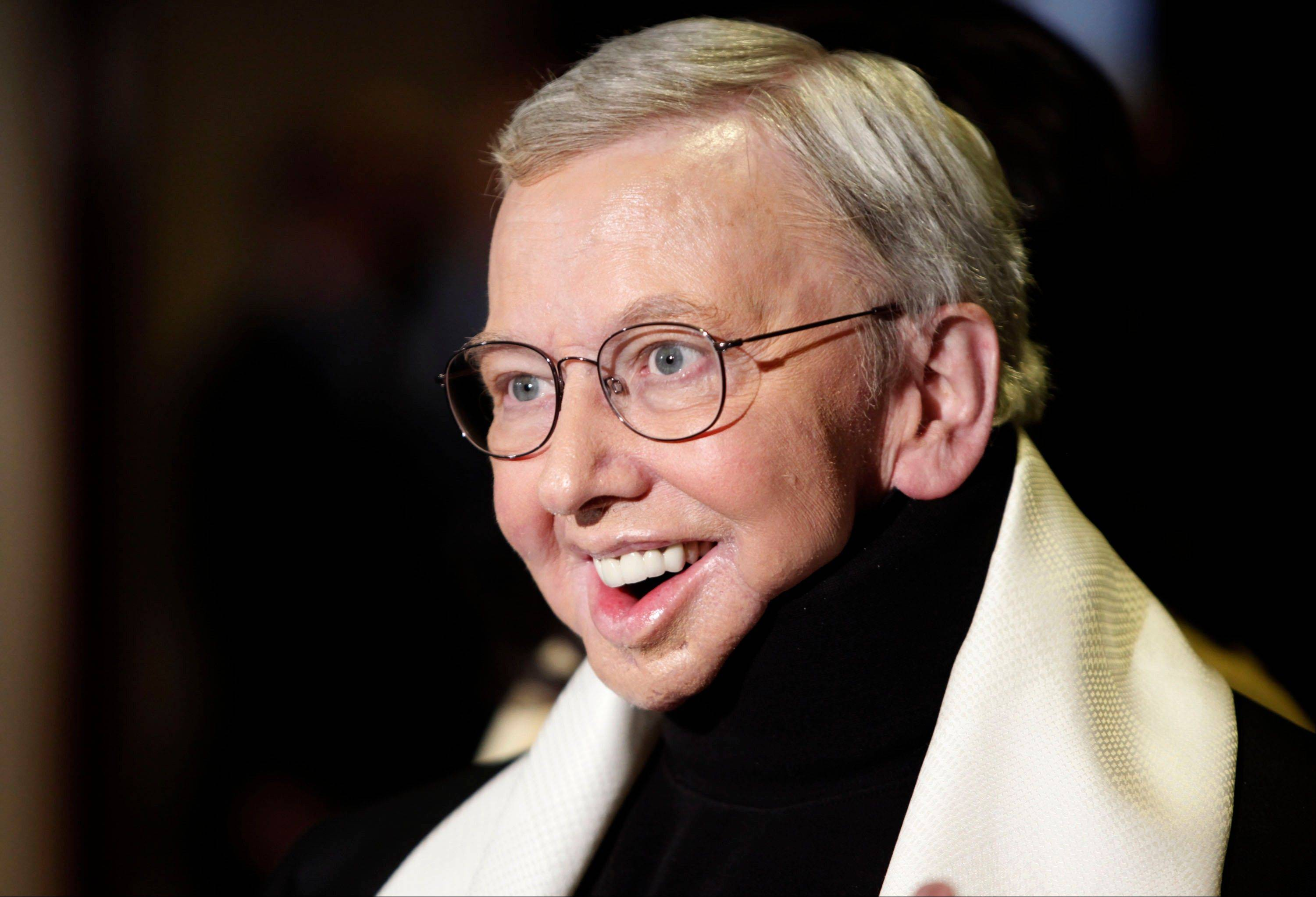 This Jan. 2009 file photo shows film critic and author Roger Ebert, recipient of the Honorary Life Member Award, at the Directors Guild of America Awards in Los Angeles. Ebert, the most famous and most popular film reviewer of his time, died April 4, 2013. He was 70.