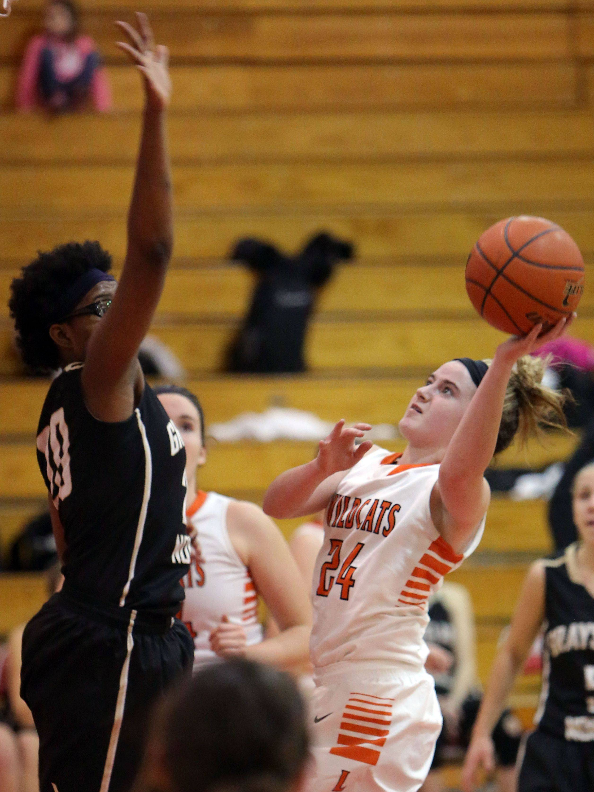 Libertyville�s Rosie Lynch, right, drives on Grayslake North�s Brittany Thibeaux on Thursday at Mundelein High School.