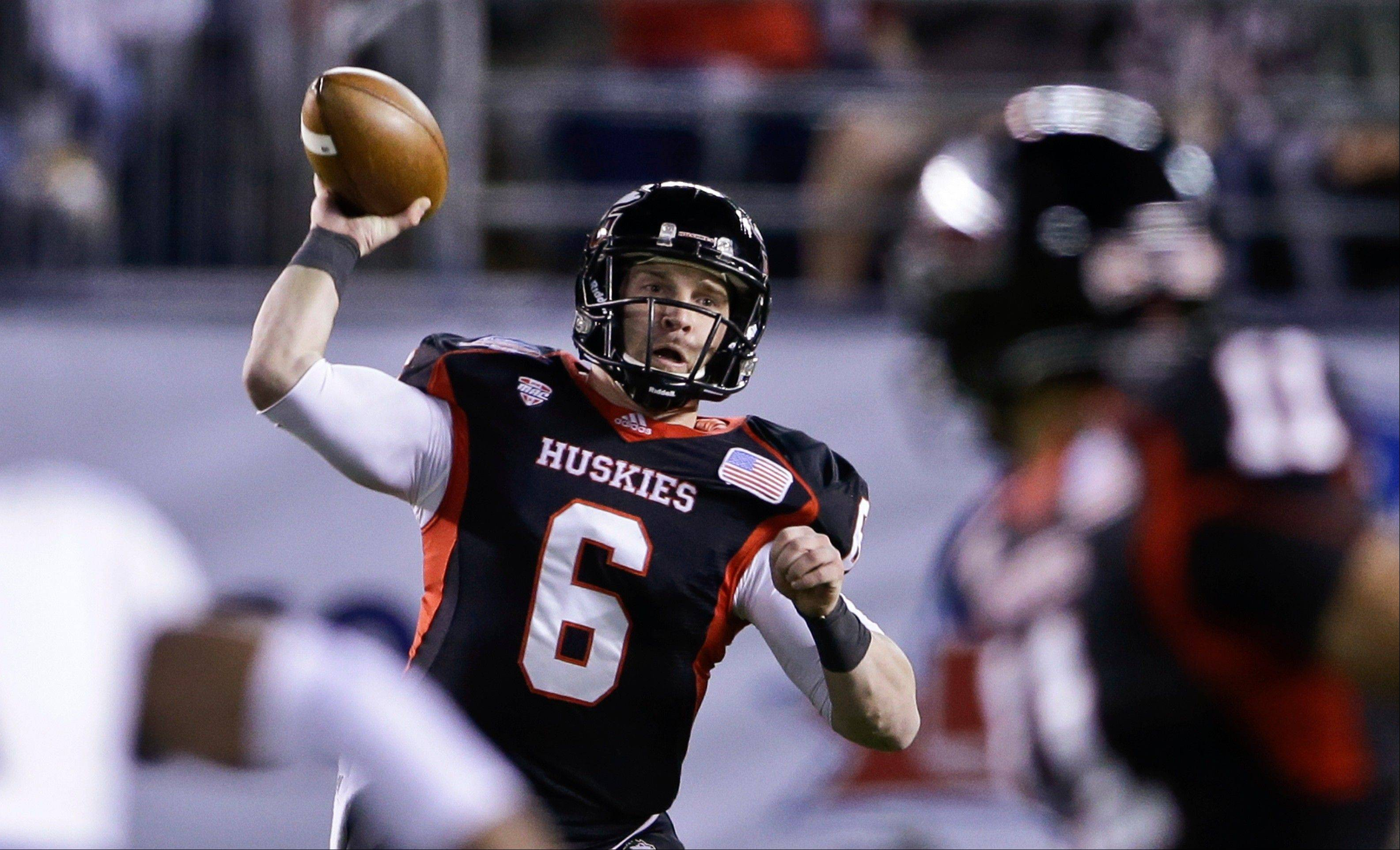 Northern Illinois quarterback Jordan Lynch throws a pass against Utah State during the first half of the Poinsettia Bowl on Thursday in San Diego.