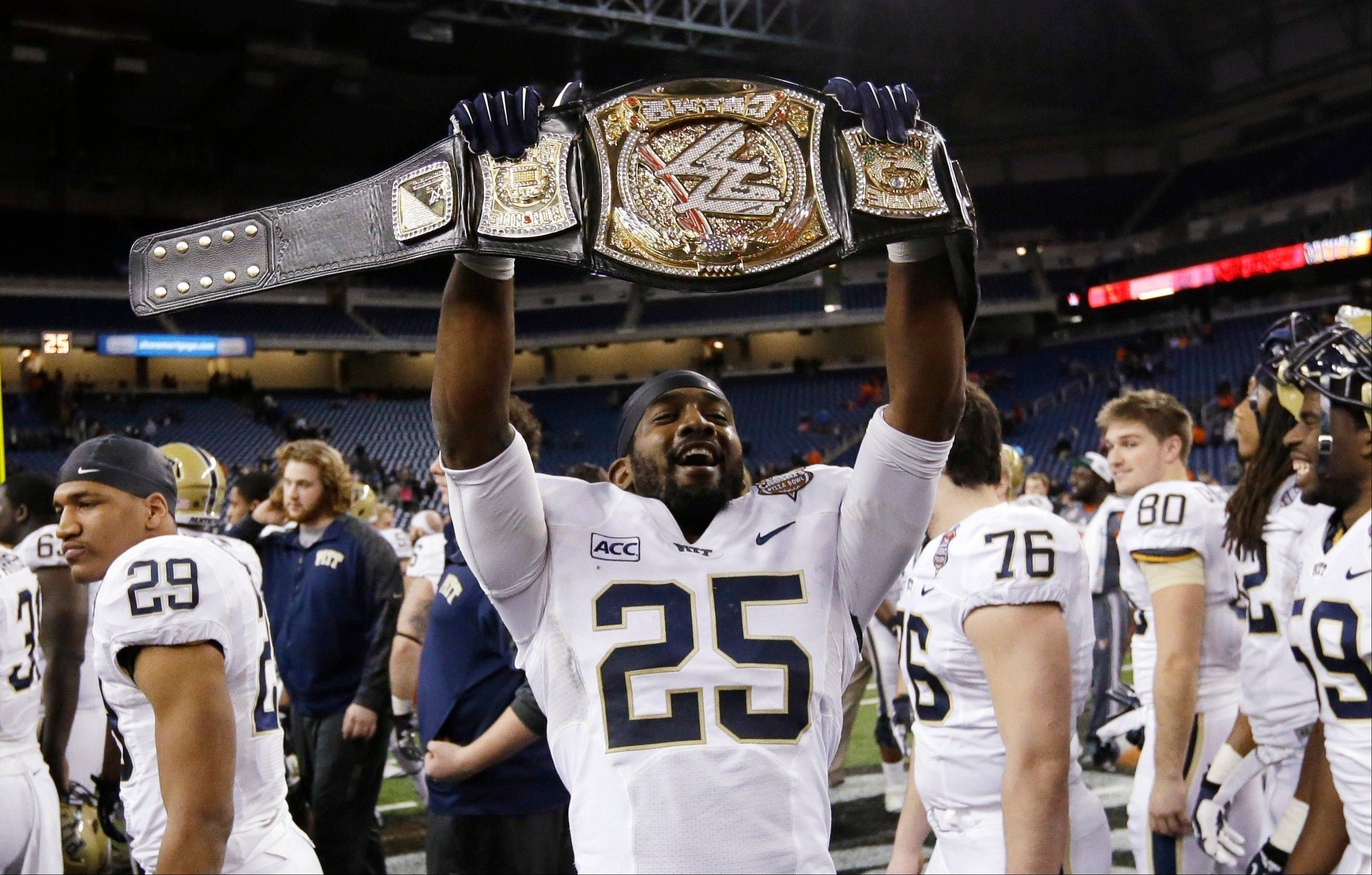Pittsburgh defensive back Jason Hendricks holds up a wrestling championship belt after the Panthers defeated Bowling Green 30-27 in the Little Caesars Pizza Bowl on Thursday in Detroit.