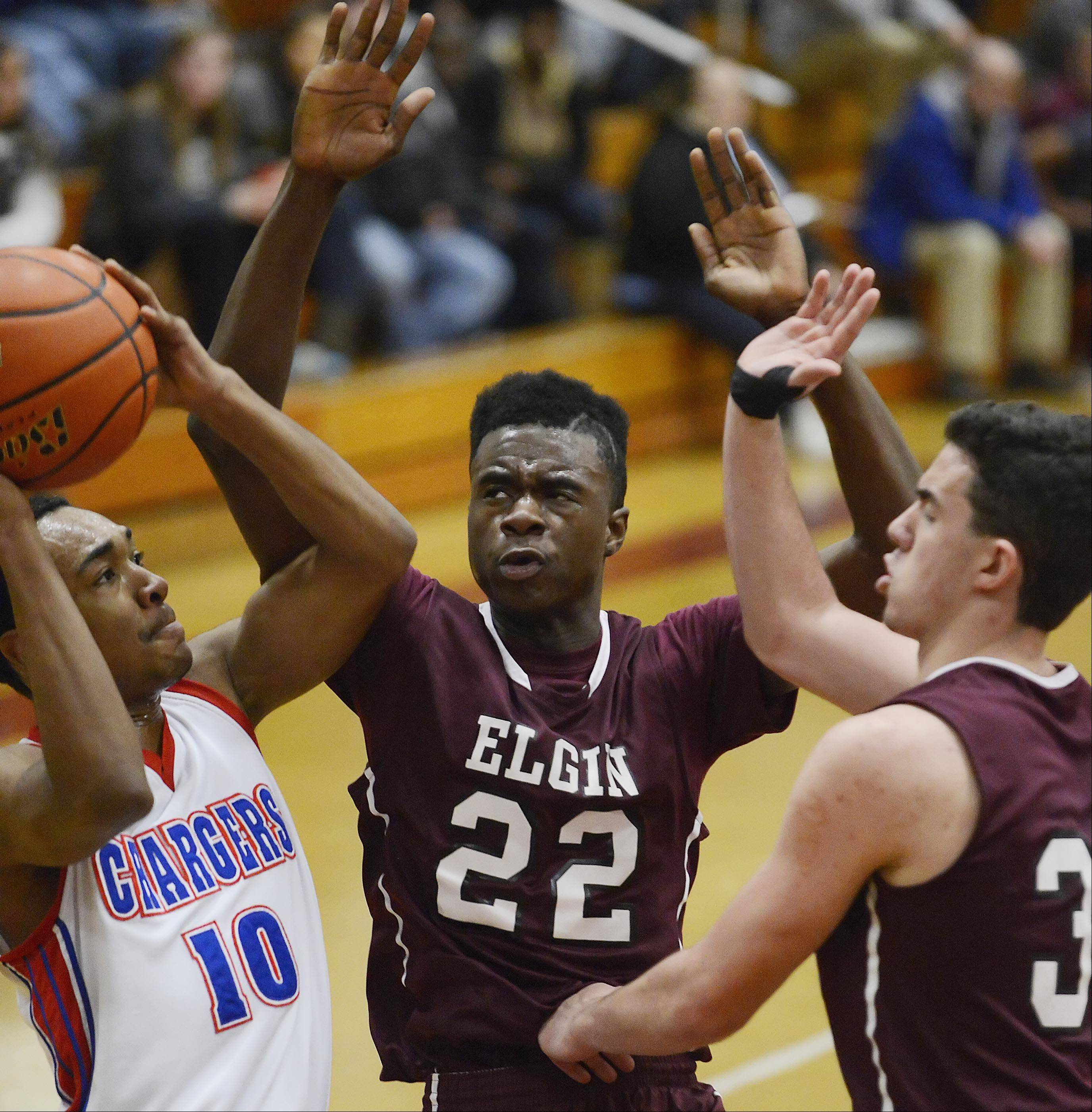 Elgin�s Desmond Sanders and Mike Hanneman defend Dundee-Crown�s Kiwaun Seals Thursday in the quarterfinal game of the Elgin Holiday Tournament.