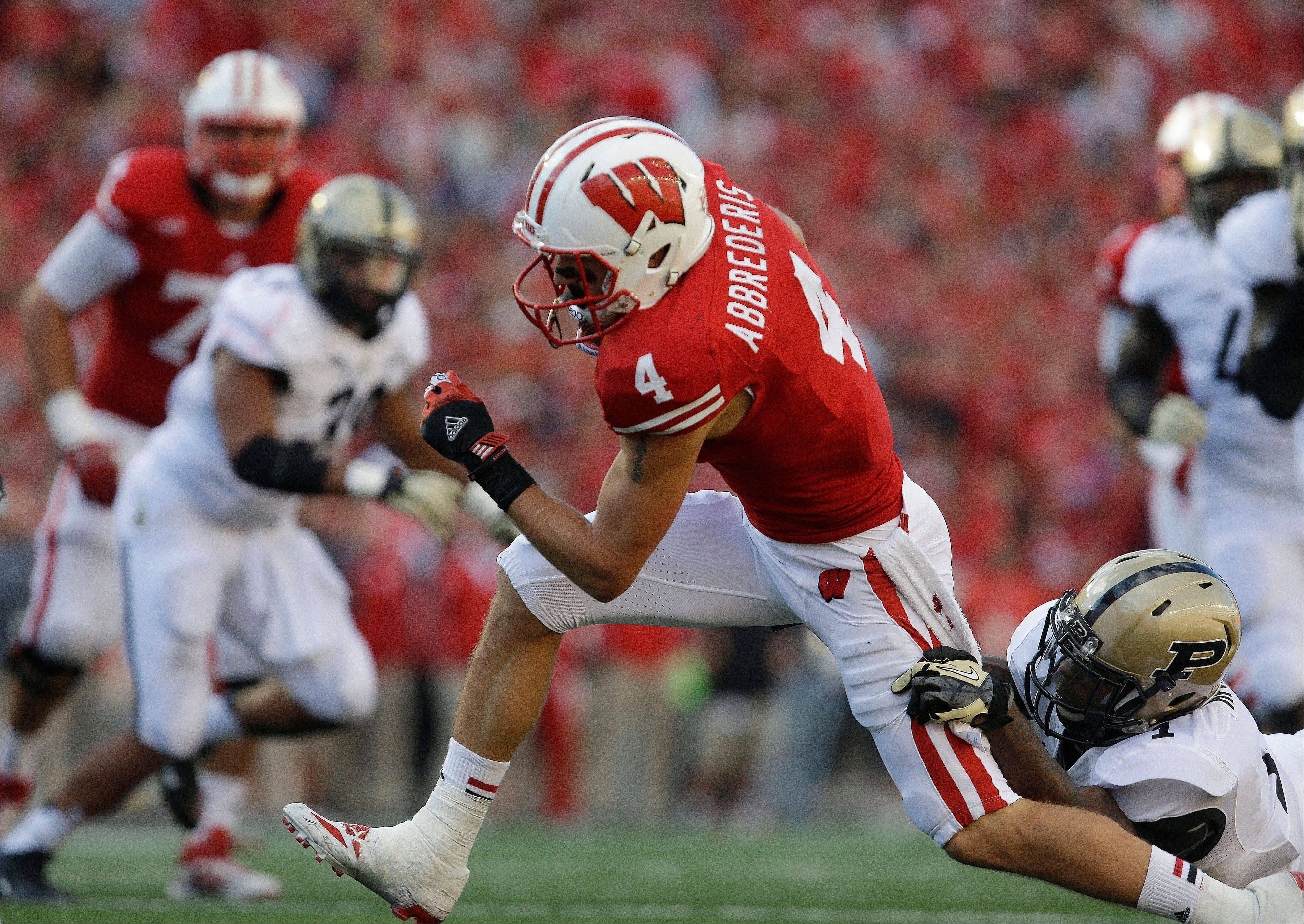 Wisconsin�s Jared Abbrederis runs with a reception during a game against Purdue in Madison, Wis. From scout team quarterback to indispensable senior receiver, Abbrederis has set a new standard for walk-ons at No. 19 Wisconsin.