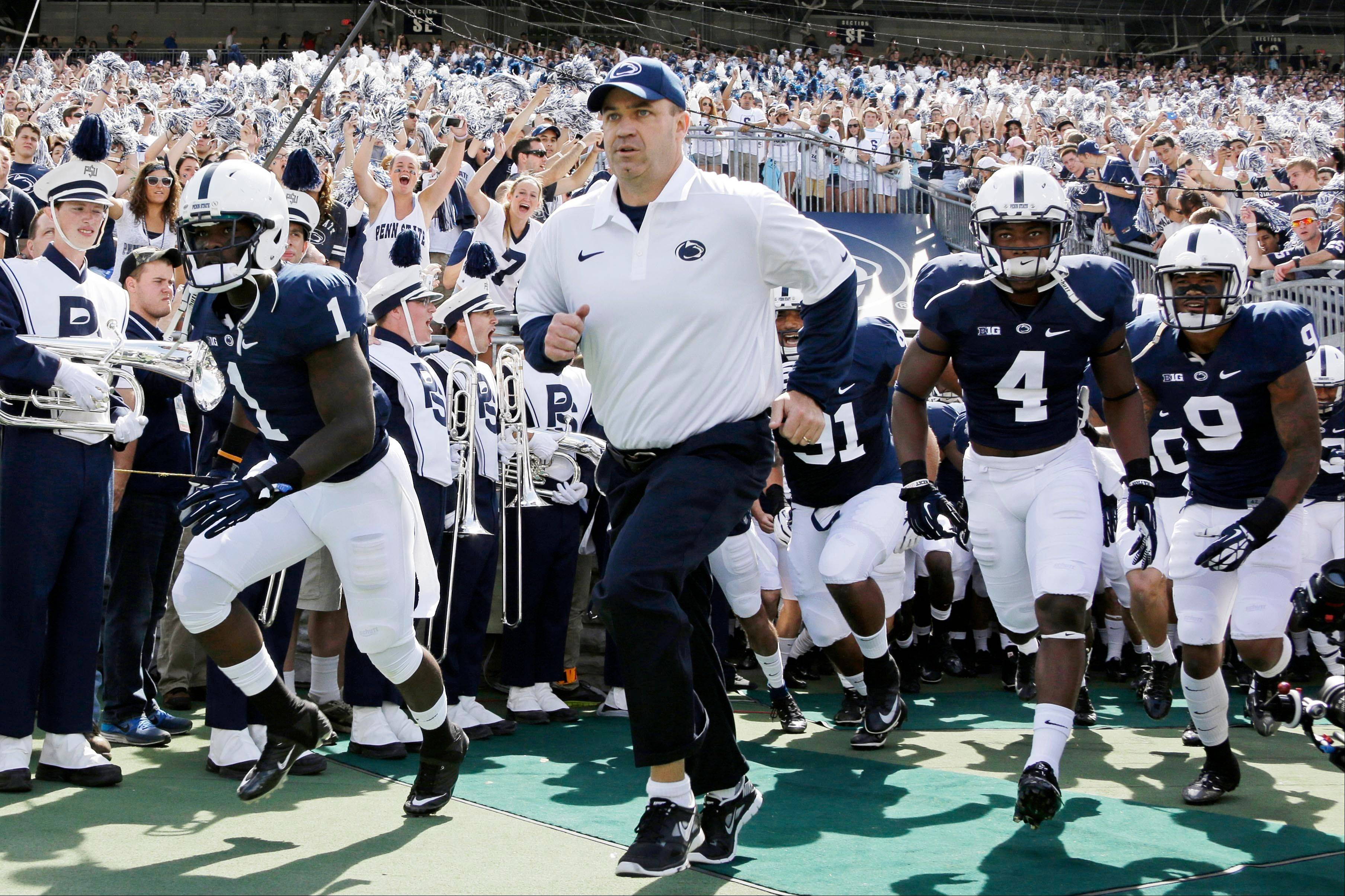 Penn State head coach Bill O� Brien leads his team onto the field at Beaver Stadium for a Sept. 7 game against Eastern Michigan in State College, Pa. The Nittany Lions have had two years of modified success under O�Brien.