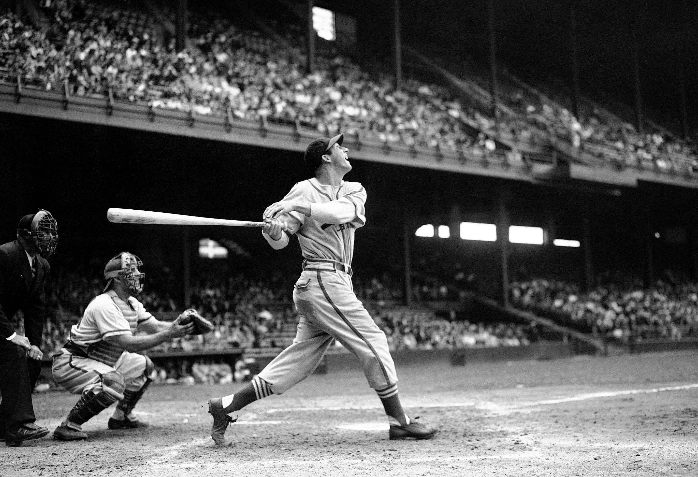 In this May 22, 1946 file photo, St. Louis Cardinals� Stan Musial bats against the Philadelphia Phillies during a baseball game at Shibe Park in Philadelphia. Musial, one of baseball�s greatest hitters and a Hall of Famer with the Cardinals for more than two decades, died Saturday, Jan 19, 2013. He was 92.