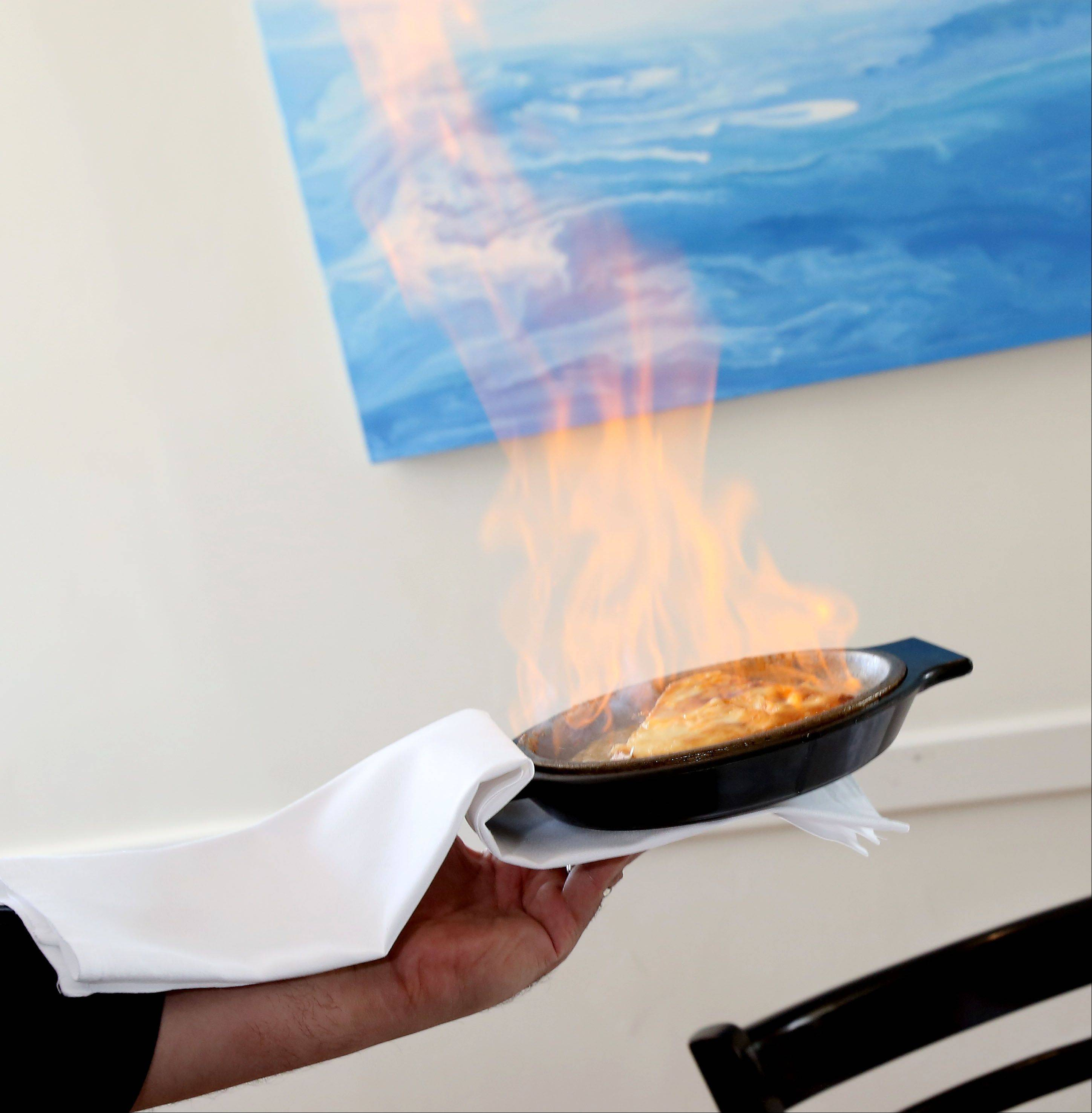 Flaming saganaki turns every meal at Opa! Estiatorio into a celebration.