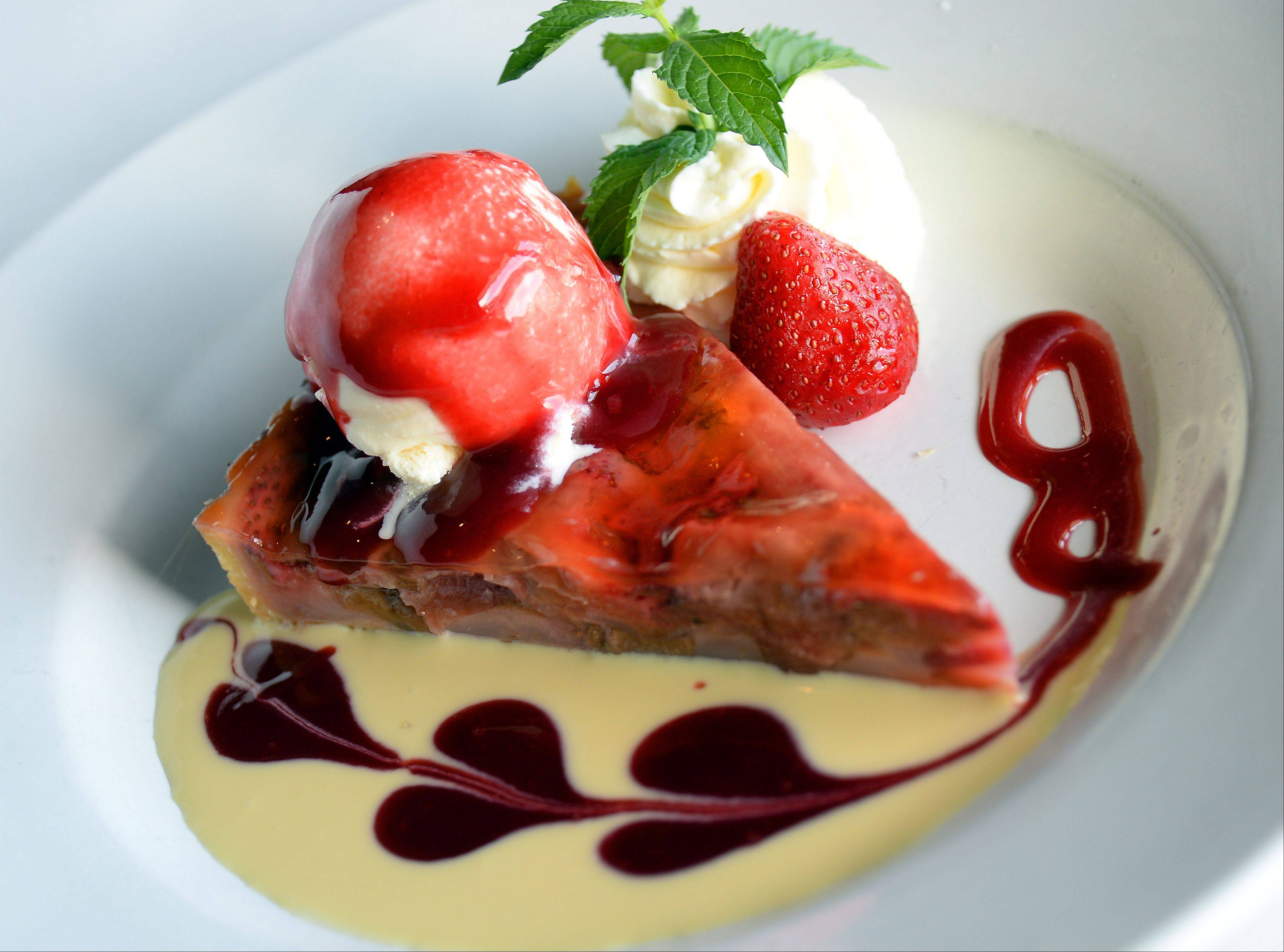 Besides classic French sausages and fish preparations, Retro Bistro in Mount Prospect serves seasonal desserts like this rhubarb and strawberry tart.