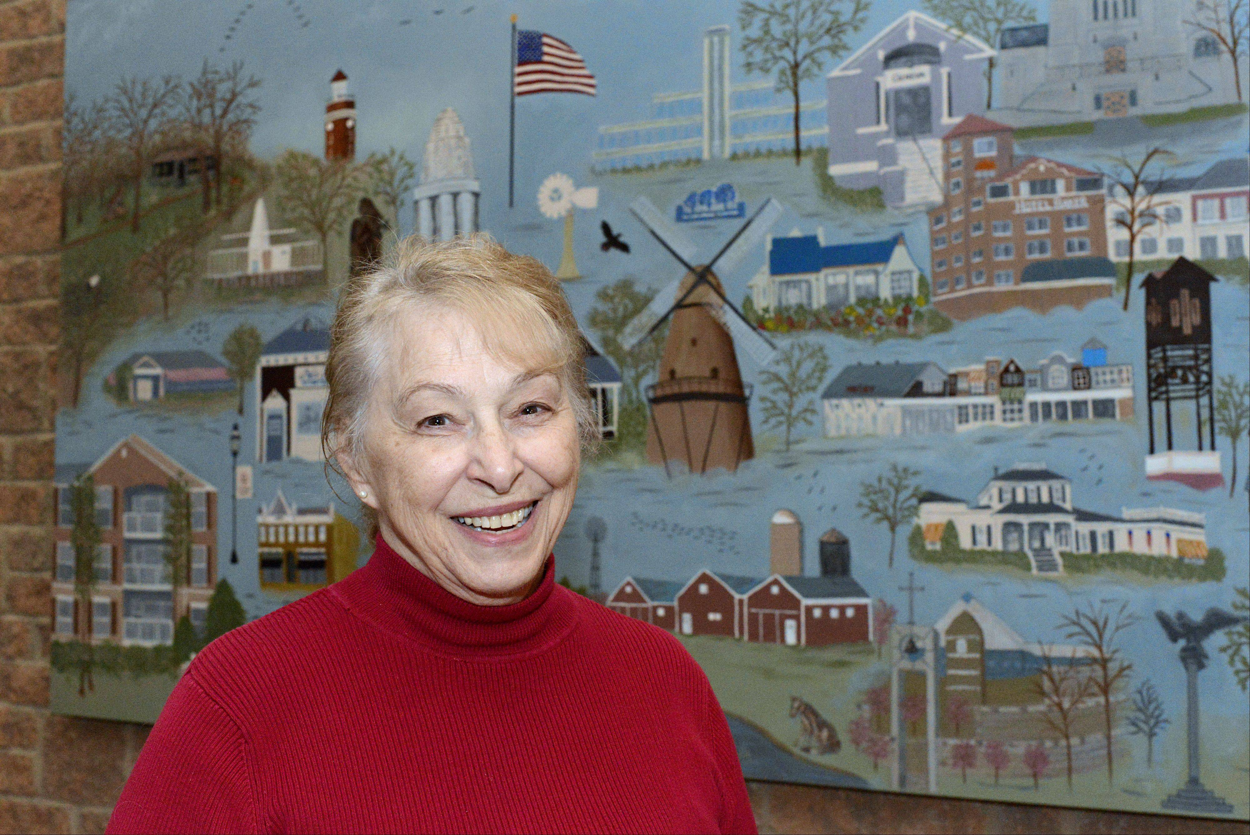 Flora Kaindl, resident of The Crossings in Geneva, painted two murals for the community room of the senior living condo complex. Both took about six months. One mural is of landmark buildings in the Tri Cities/Fox Valley area. The other is a triptych of the Chicago skyline, with fellow residents adding touches to the flower, sailboats and skyscrapers.