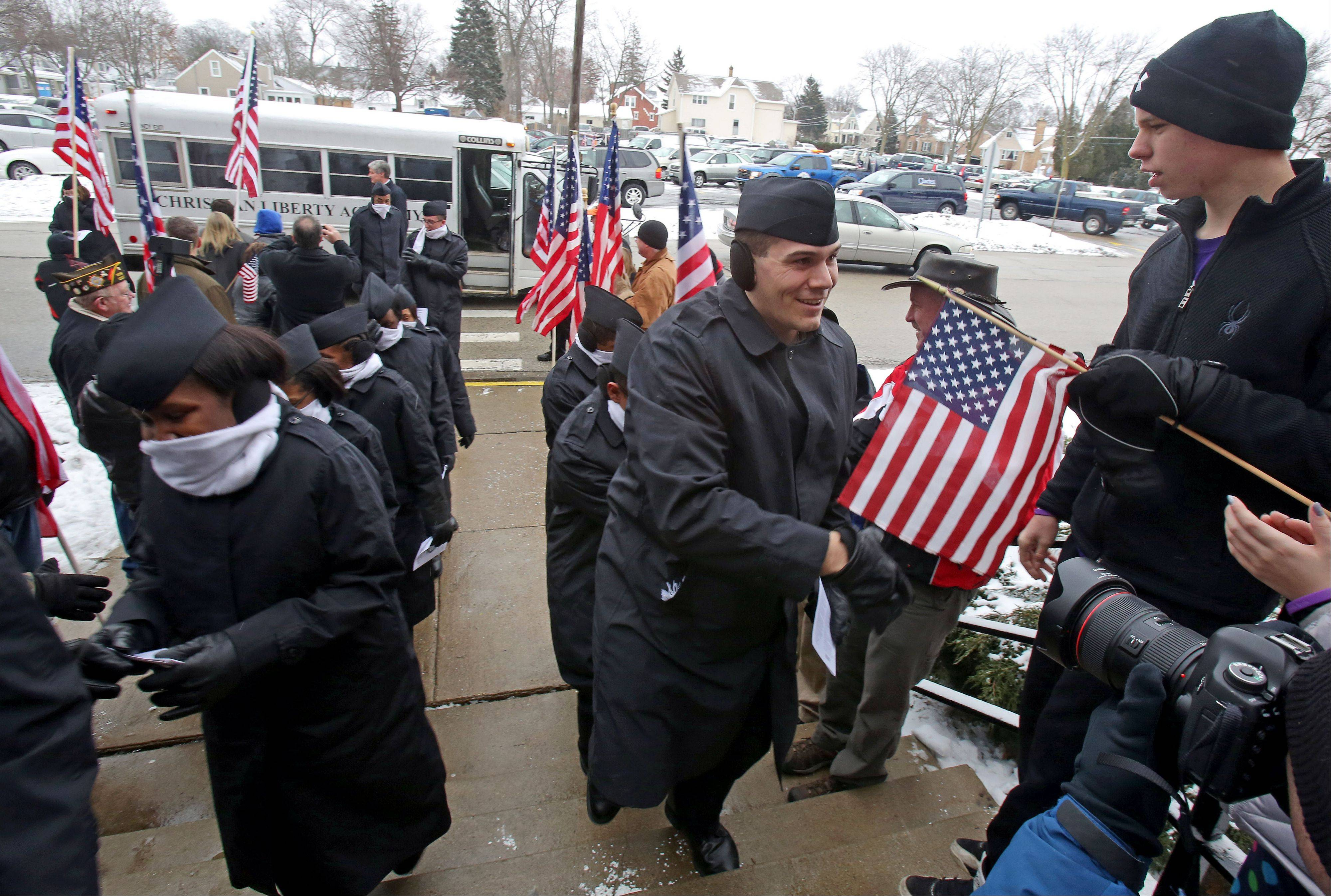 Recruits from Great Lakes Naval Base are greeted by volunteers at Christian Liberty Academy in Arlington Heights Wednesday morning.