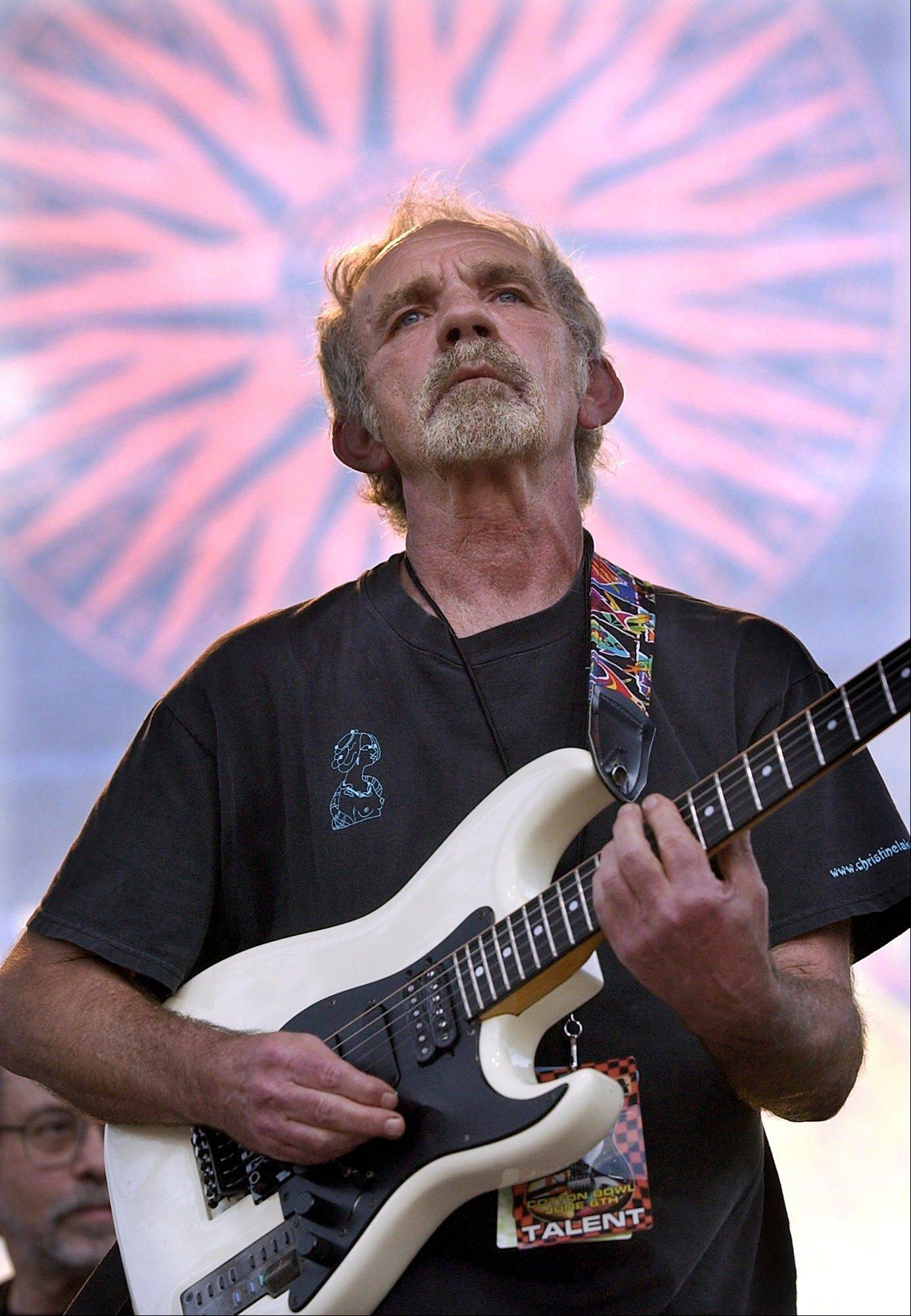 "In this June 5, 2004 file photo, singer-songwriter J.J. Cale plays during the Eric Clapton Crossroads Guitar Festival in Dallas. Cale, whose best-known songs became hits for Eric Clapton with ""After Midnight"" and Lynyrd Skynyrd with ""Call Me the Breeze,"" died July 26, 2013. He was 74."