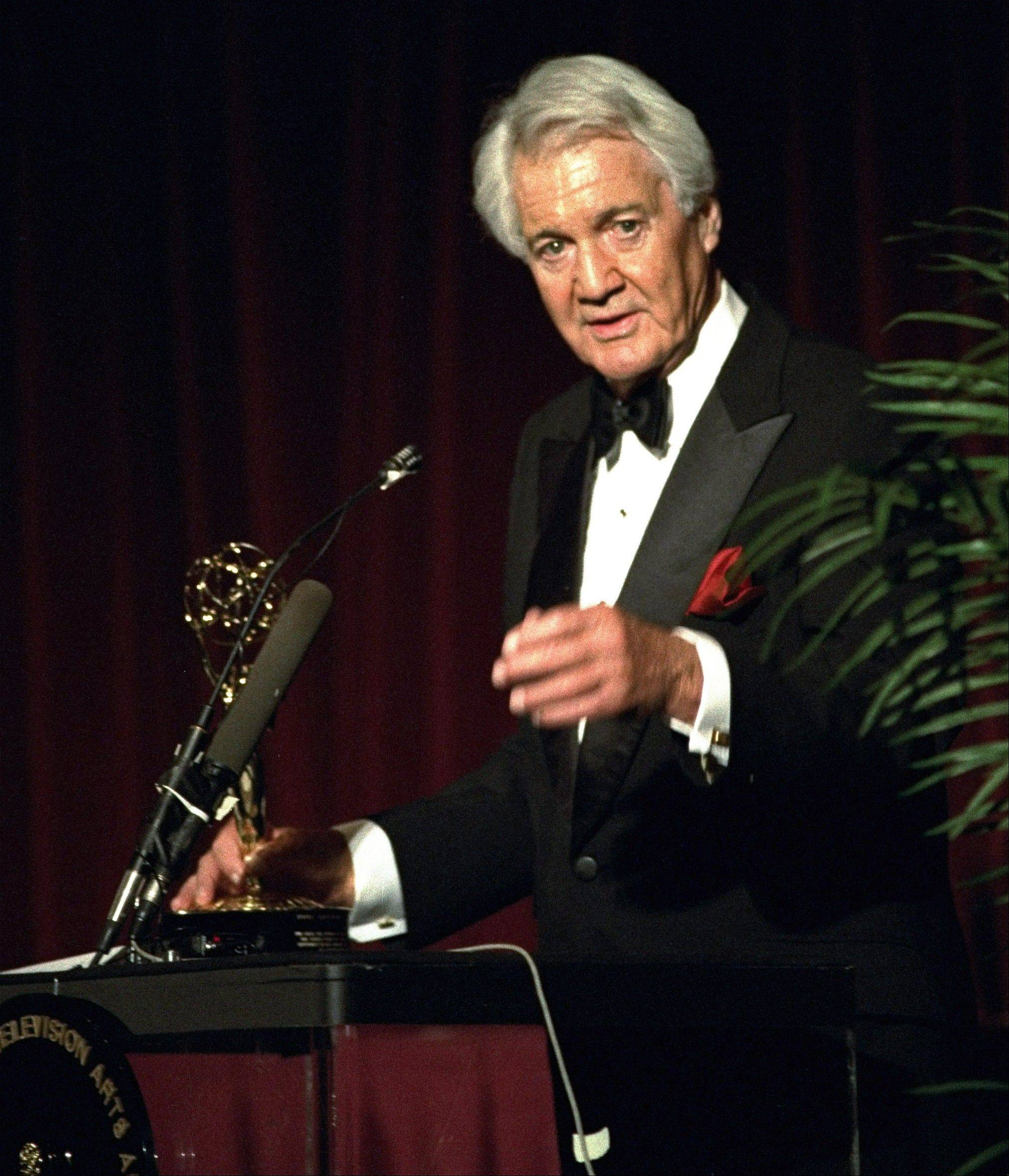 In this April 19, 1994, file photo, Pat Summerall, completing his 34th and final season with CBS, receives an award for lifetime achievement at the 1994 Sports Emmy Awards in New York. Summerall, the NFL player-turned-broadcaster whose deep, resonant voice called games for more than 40 years, died April 16, 2013. He was 82.