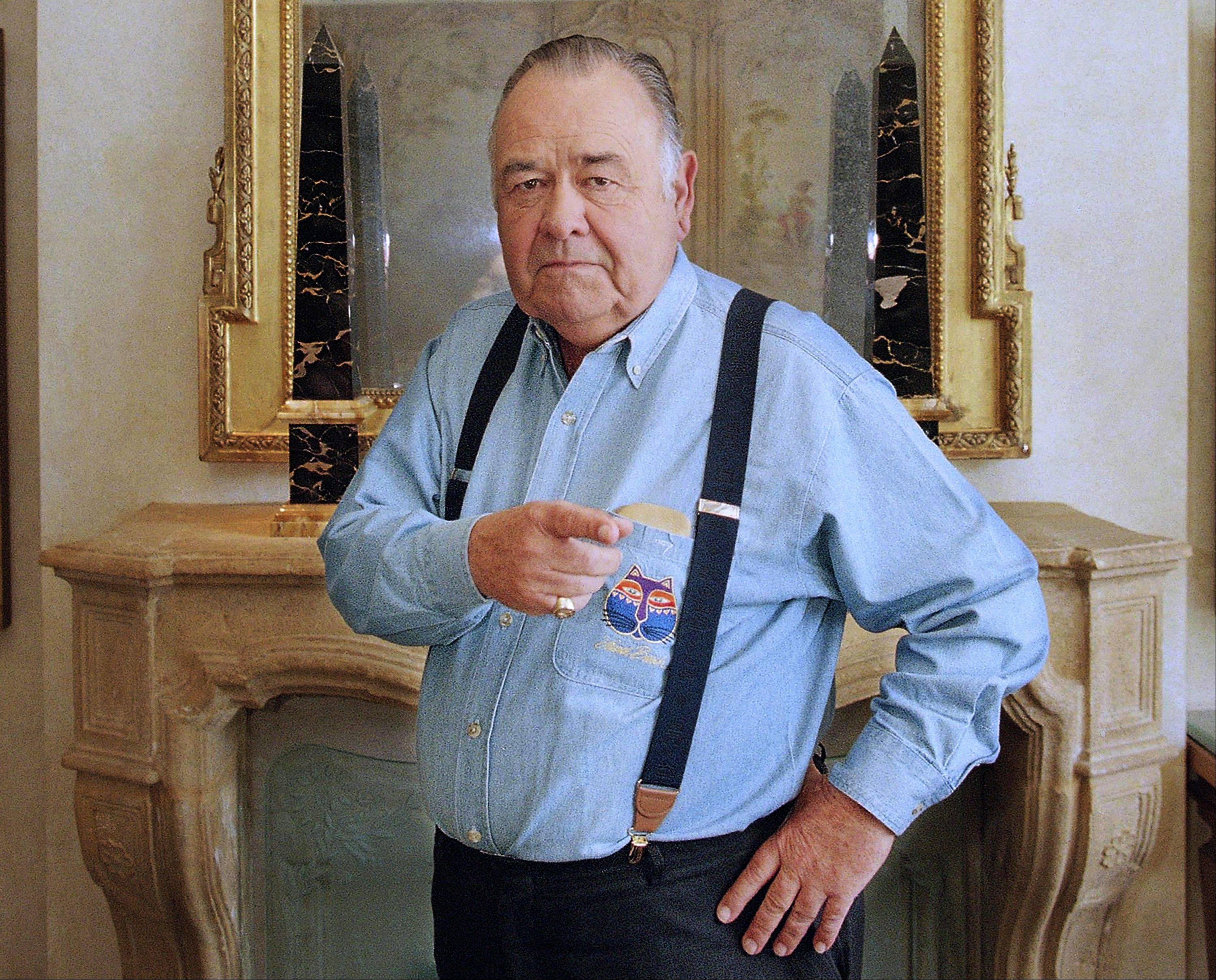 In this May 6, 1997 file photo, comedian Jonathan Winters poses at a hotel in Beverly Hills, Calif. Winters, whose breakneck improvisations inspired Robin Williams, Jim Carrey and many others, died Thursday, April 11, 2013, at his Montecito, Calif., home of natural causes. He was 87.