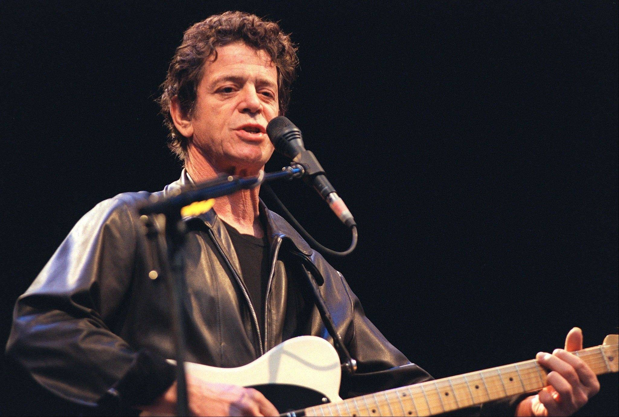 "In this July 30, 2000 file photo, Lou Reed performs onstage at the open air ""Live at Sunset"" concert in Zurich, Switzerland. Reed, the punk poet of rock 'n' roll who profoundly influenced generations of musicians as leader of the Velvet Underground and remained a vital solo performer for decades after, died Oct. 27, 2013. He was 71."