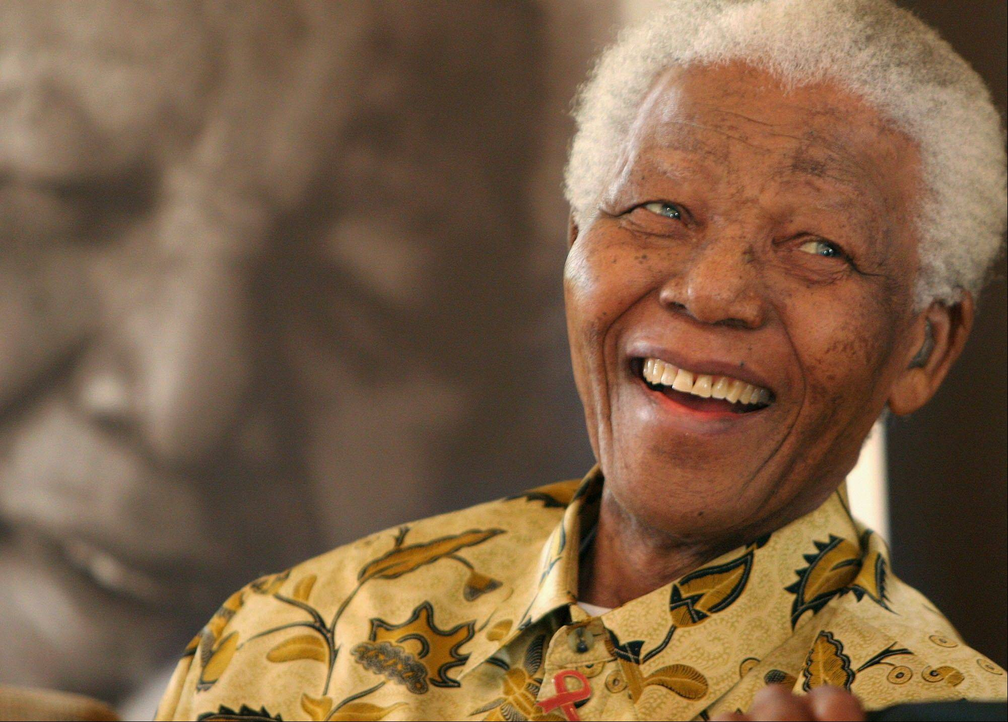 In this Dec. 7, 2005 file photo, former South African President Nelson Mandela, 87, smiles the Mandela Foundation in Johannesburg. On Thursday, Dec. 5, 2013, Mandela died at the age of 95.