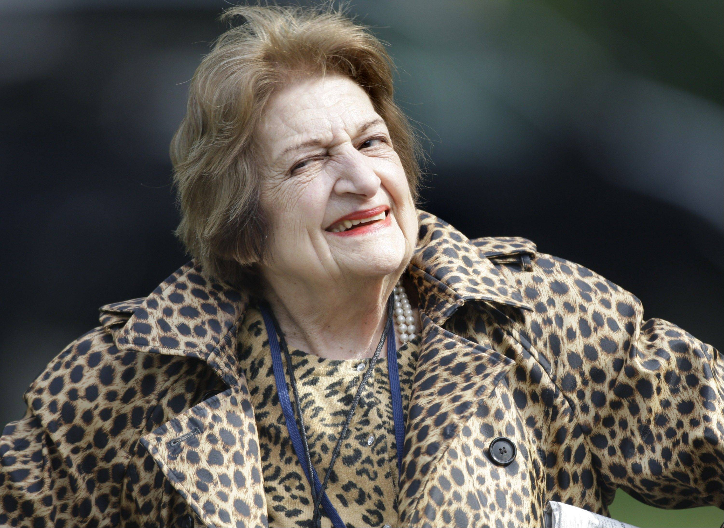 In this Oct. 16, 2007 file photo, veteran White House correspondent Helen Thomas smiles as she leaves the White House after attending a briefing. Thomas, the White House correspondent who used her seat in the front row of history to grill nine presidents, died July 20, 2013. She was 92.