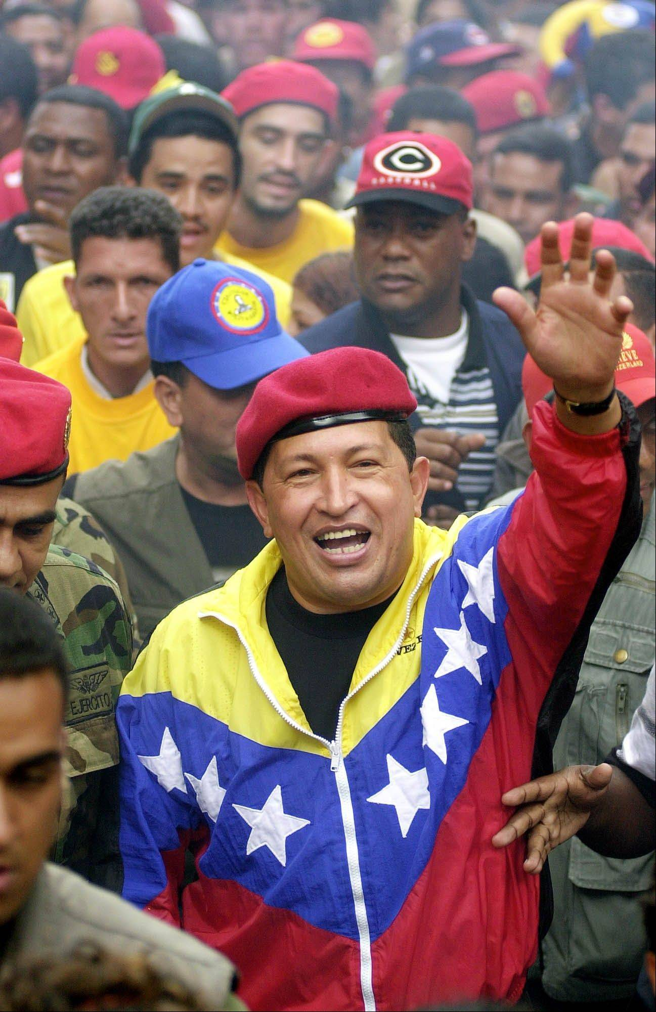 In this Jan. 23, 2002 file photo, Venezuela's President Hugo Chavez waves to supporters during a government march commemorating the anniversary of Venezuelan democracy in Caracas, Venezuela. Chavez died March 5, 2013 at age 58.