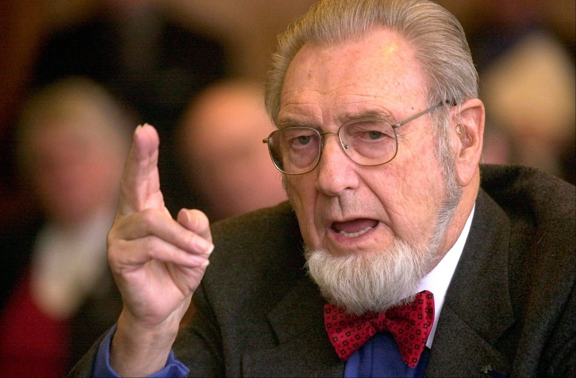 In this Feb. 12, 2002 file photo, former U.S. Surgeon General Dr. C. Everett Koop testifies in Concord, N.H. Koop, who raised the profile of the surgeon general by riveting America's attention on the then-emerging disease known as AIDS and by railing against smoking, died Feb. 25, 2013. He was 96.
